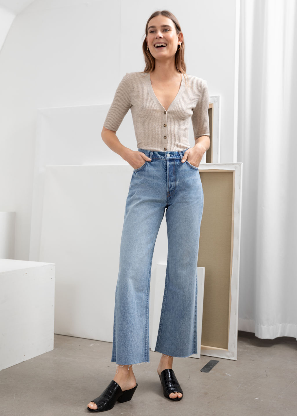 Model front image of Stories kick flare mid rise jeans in blue