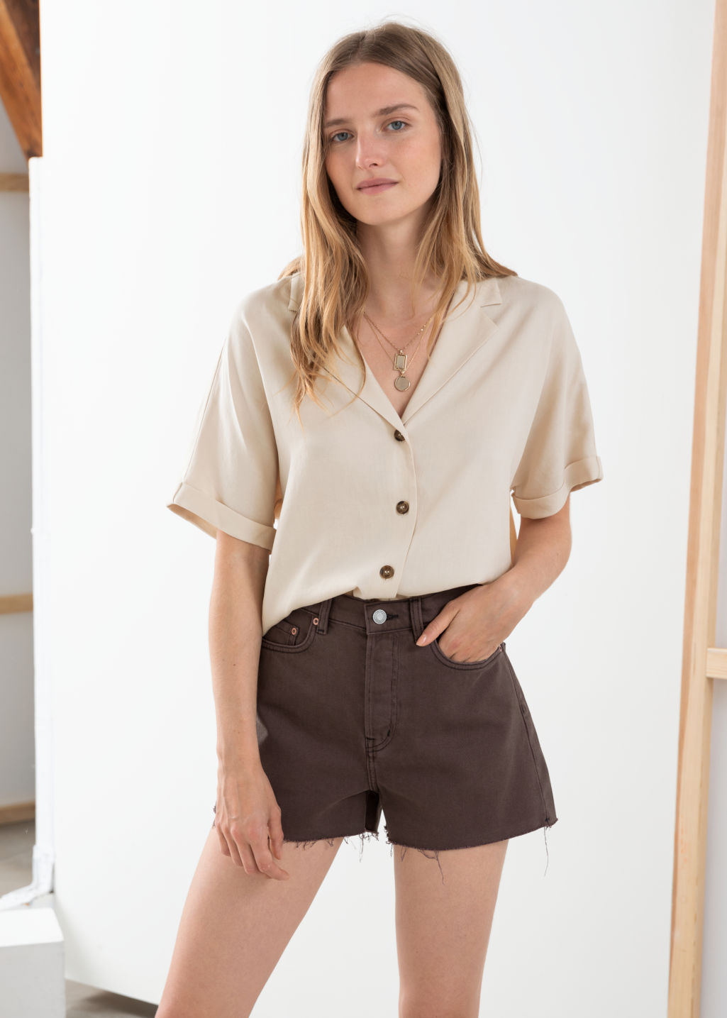 Model front image of Stories v-cut button up shirt in beige