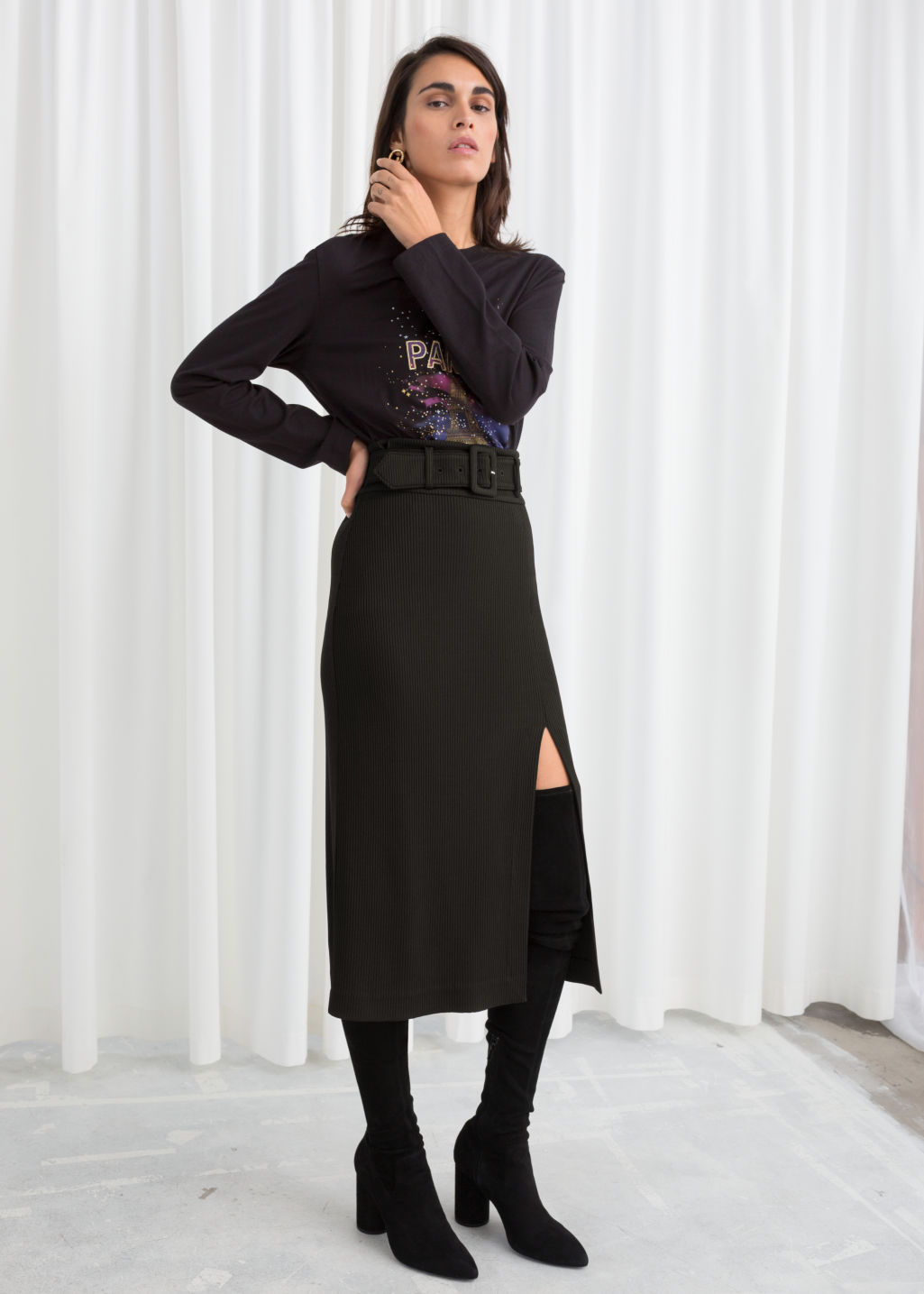 Model front image of Stories betled ribbed midi skirt in black