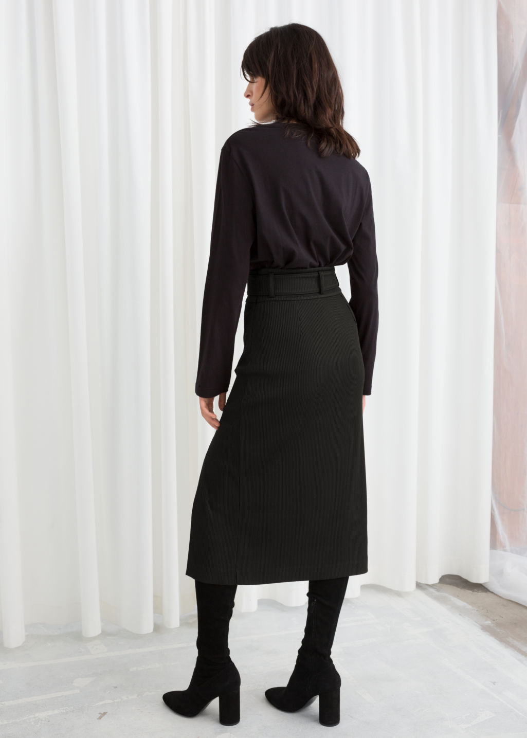 Model back image of Stories betled ribbed midi skirt in black