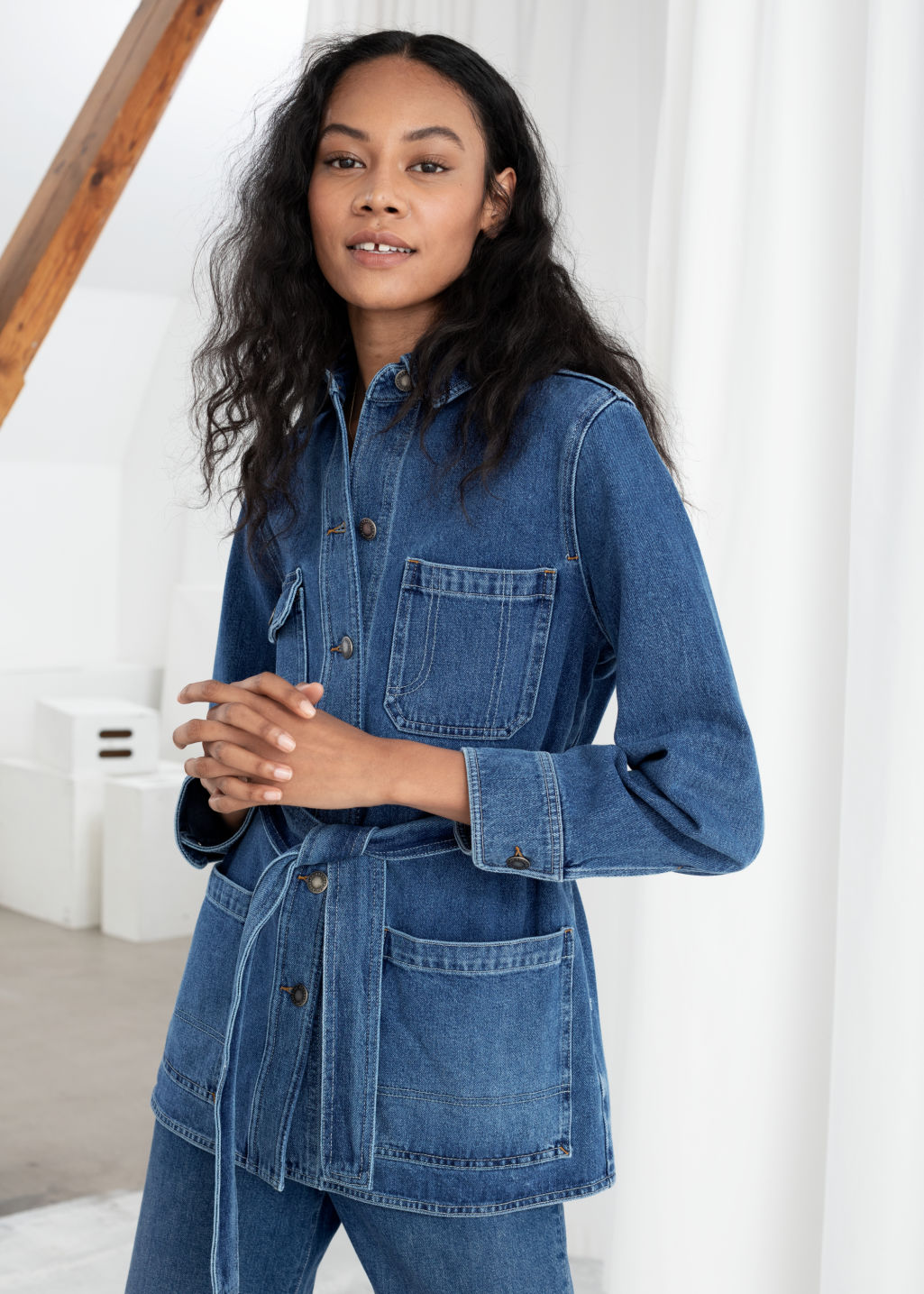 Model front image of Stories belted workwear denim jacket in blue
