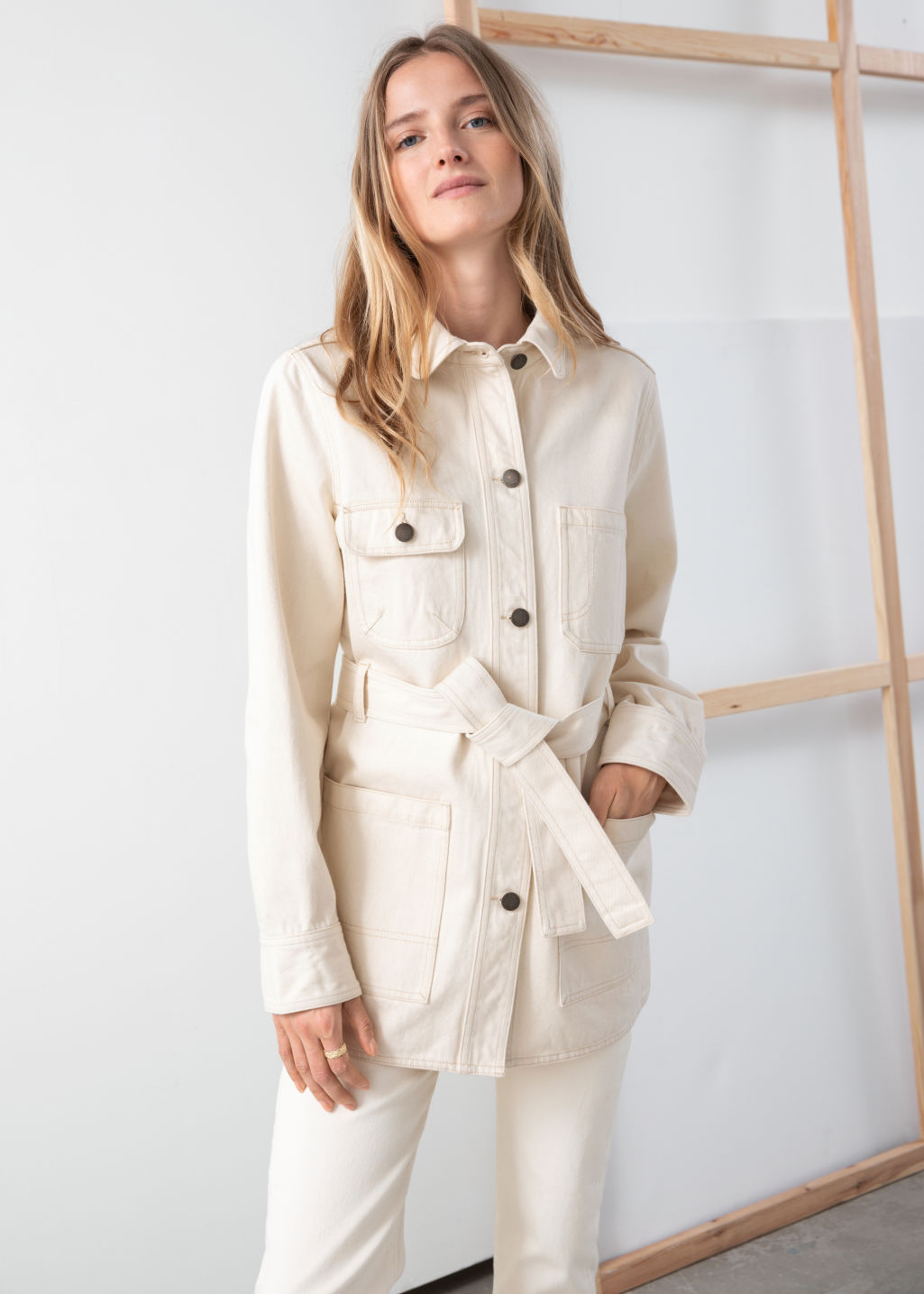 Model front image of Stories belted workwear denim jacket in white