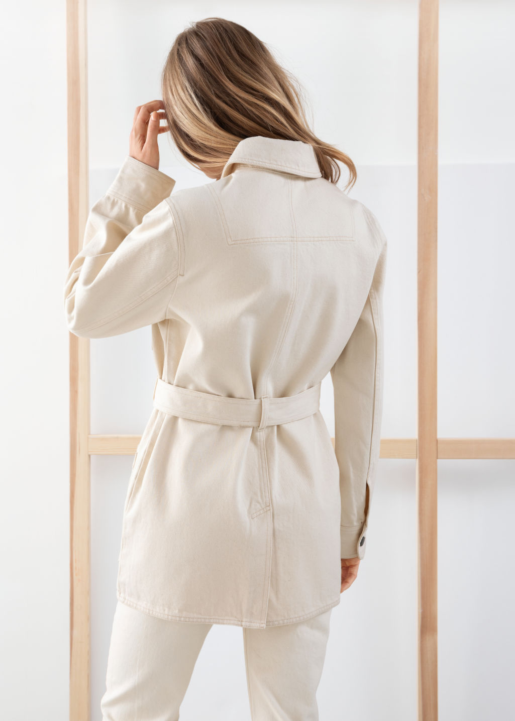 Model back image of Stories belted workwear denim jacket in white