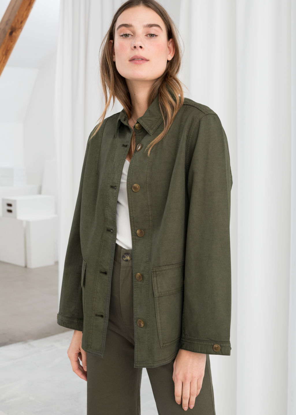 Model front image of Stories organic cotton denim workwear jacket in green
