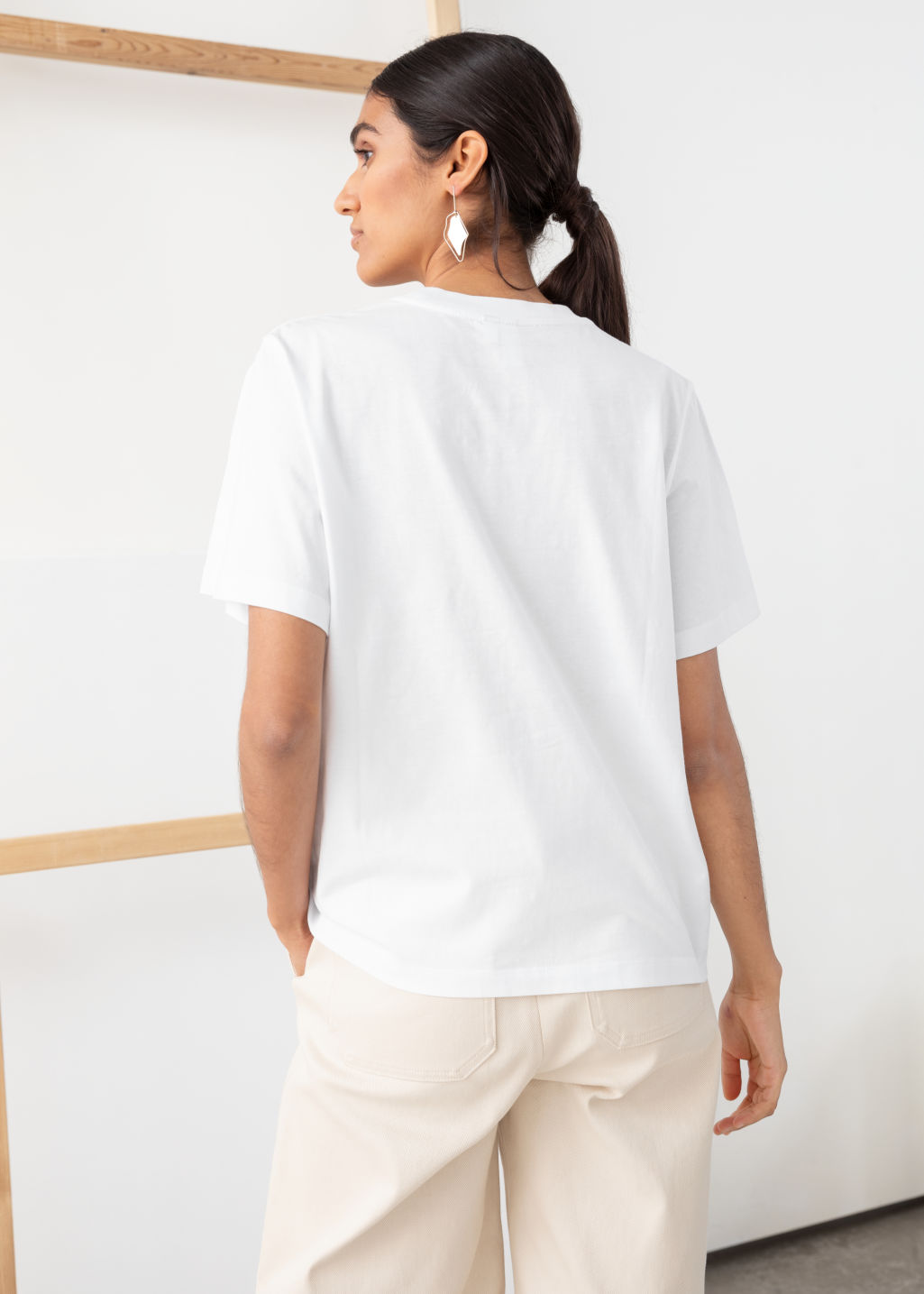 Model back image of Stories boxy organic cotton tee in white