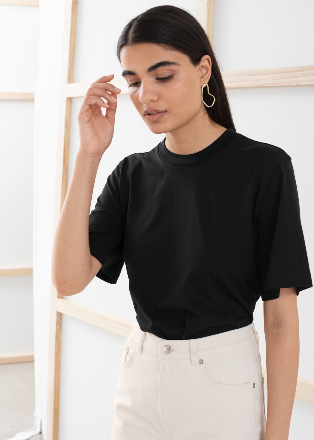 Model front image of Stories boxy organic cotton tee in black