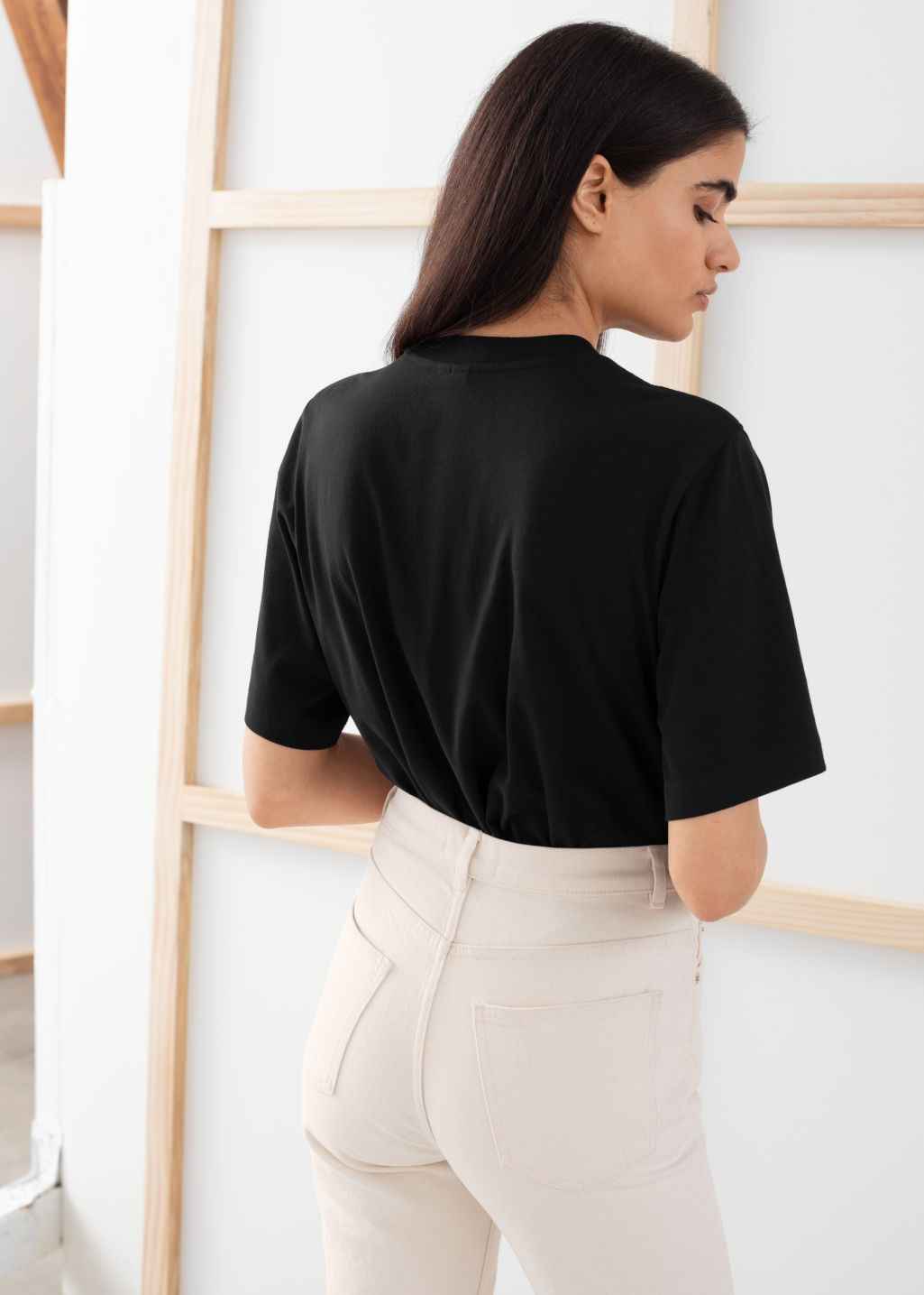 Model back image of Stories boxy organic cotton tee in black