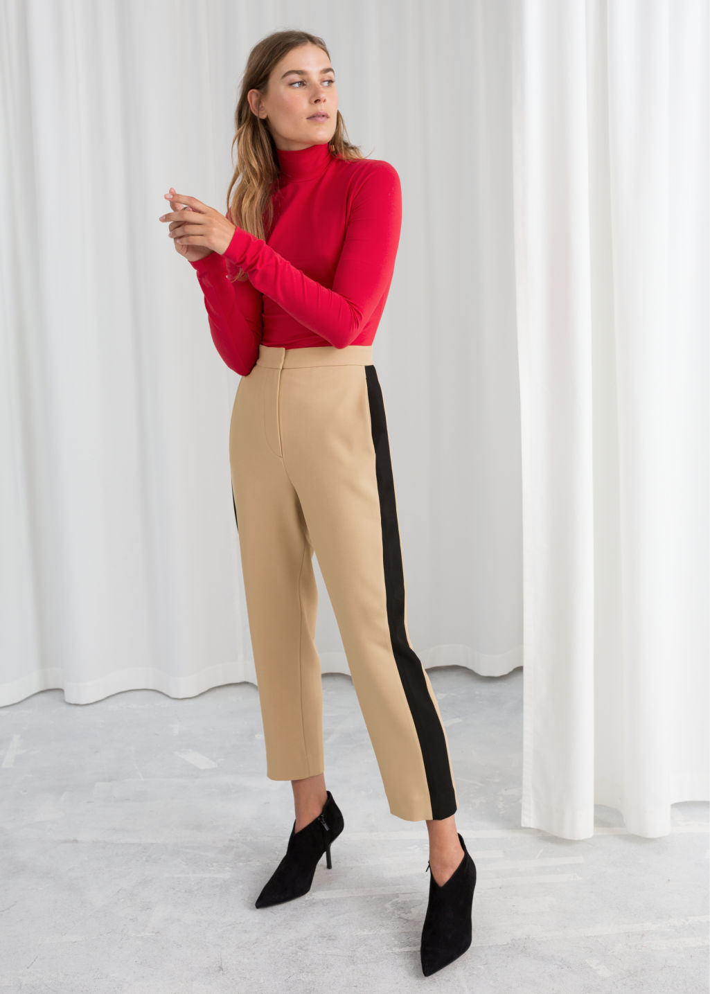 Model front image of Stories racer stripe riding trousers in beige