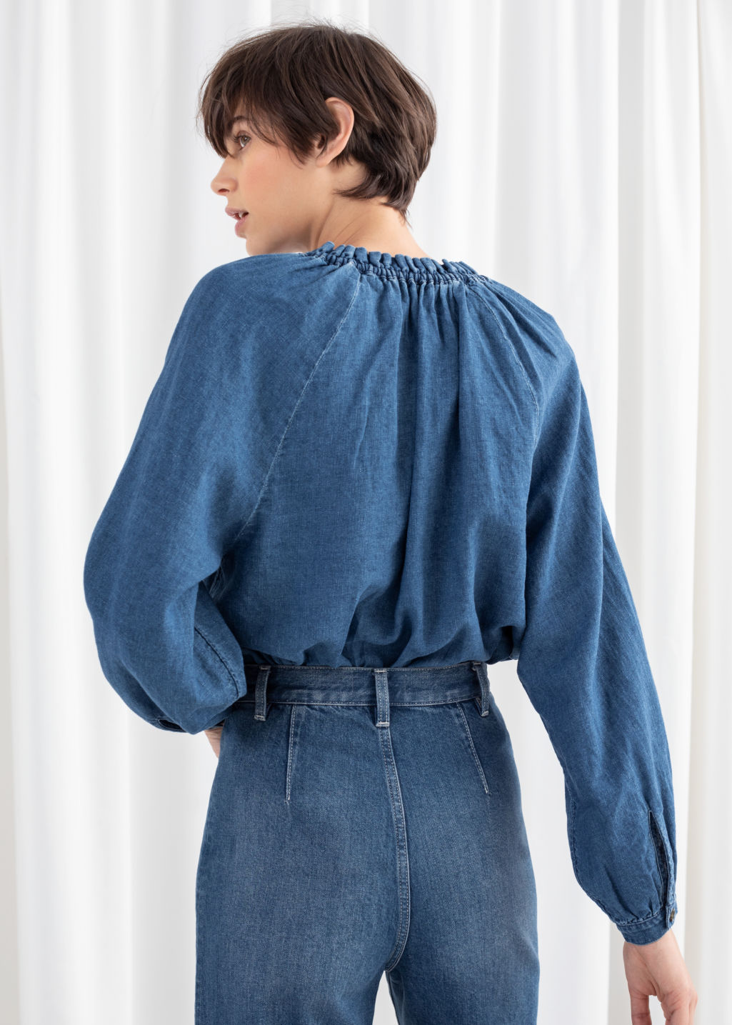 Model back image of Stories  in blue