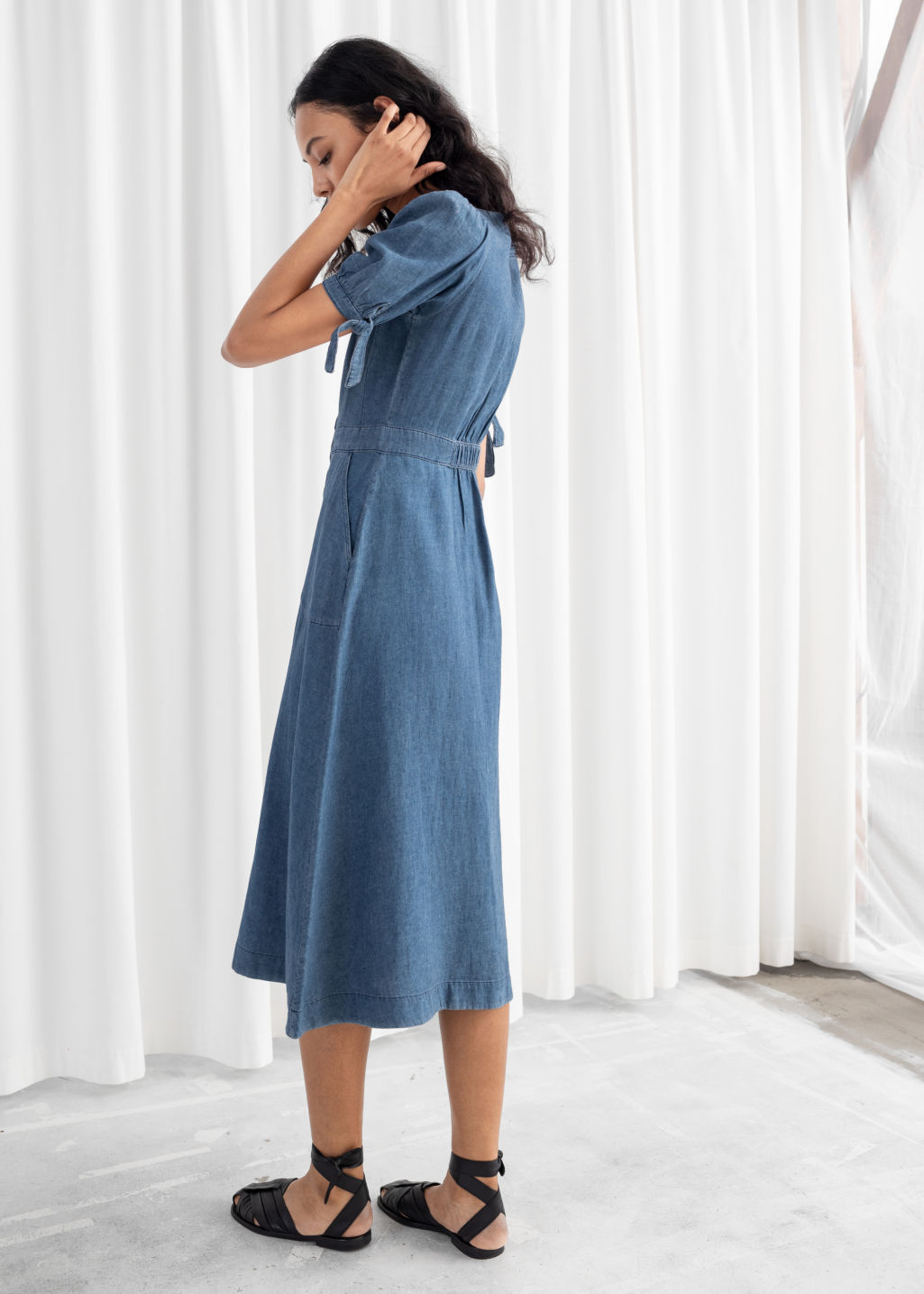 Model back image of Stories linen blend denim midi dress in blue