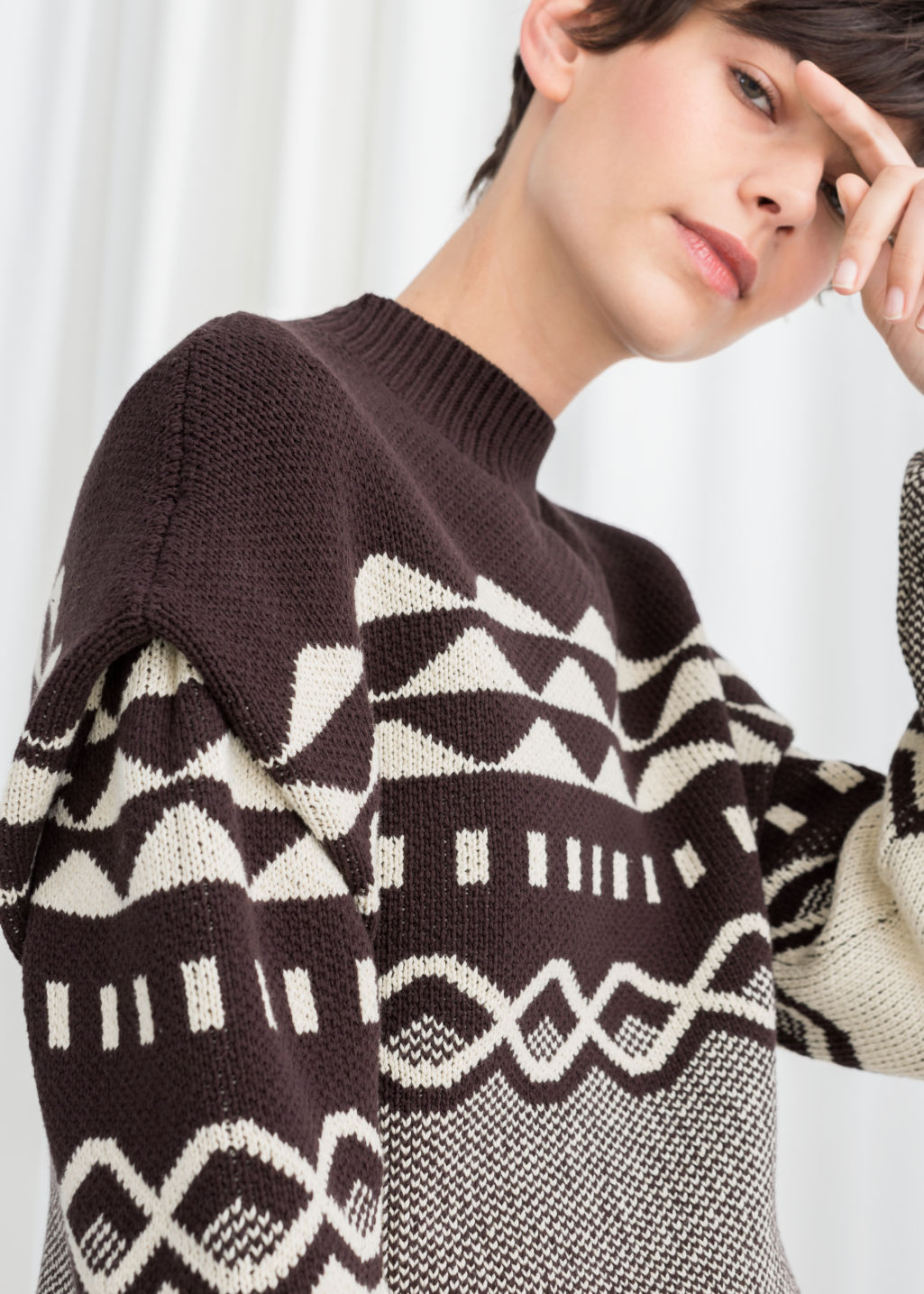 Model front image of Stories graphic cotton knit sweater in brown