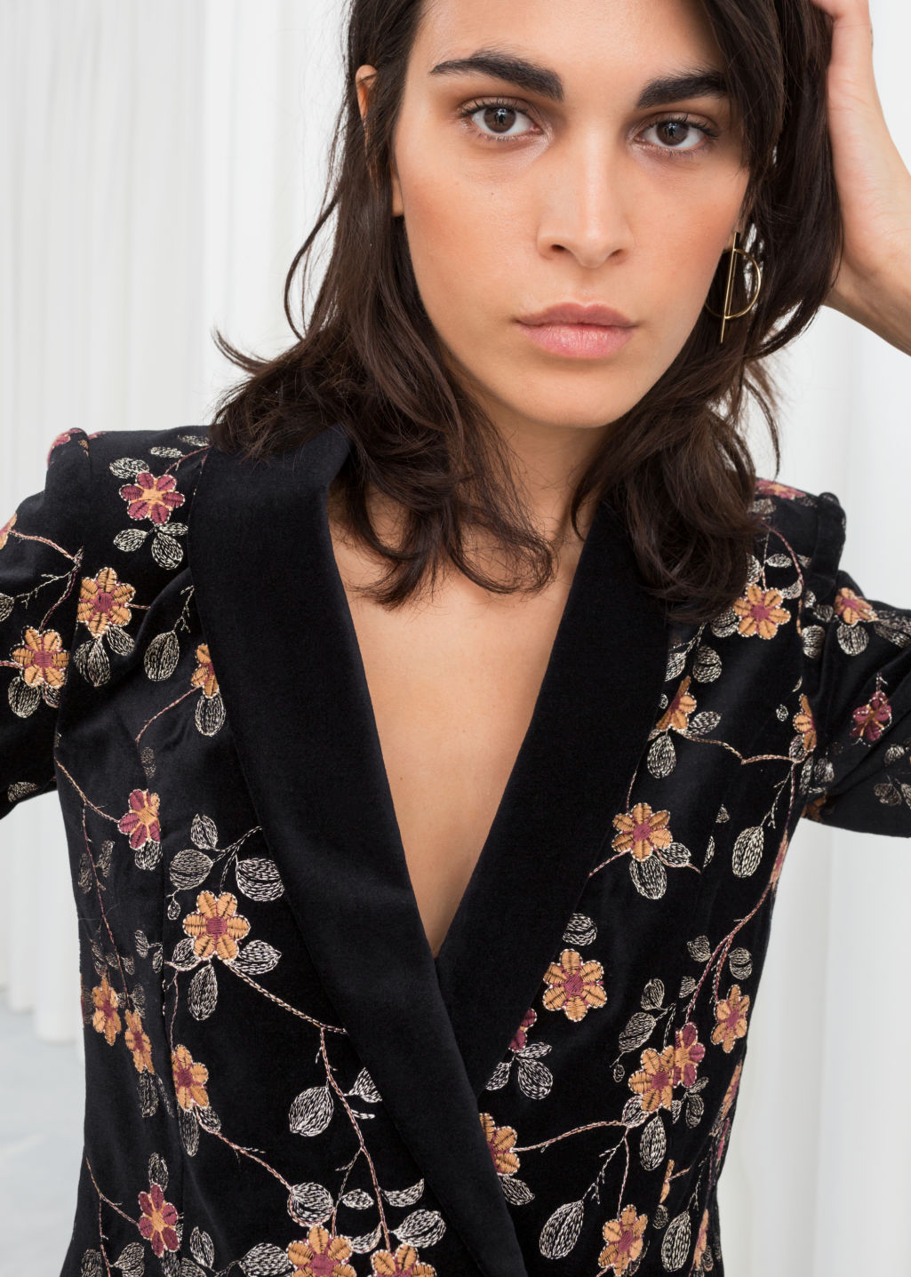 Model front image of Stories floral embroidered velvet blazer in black