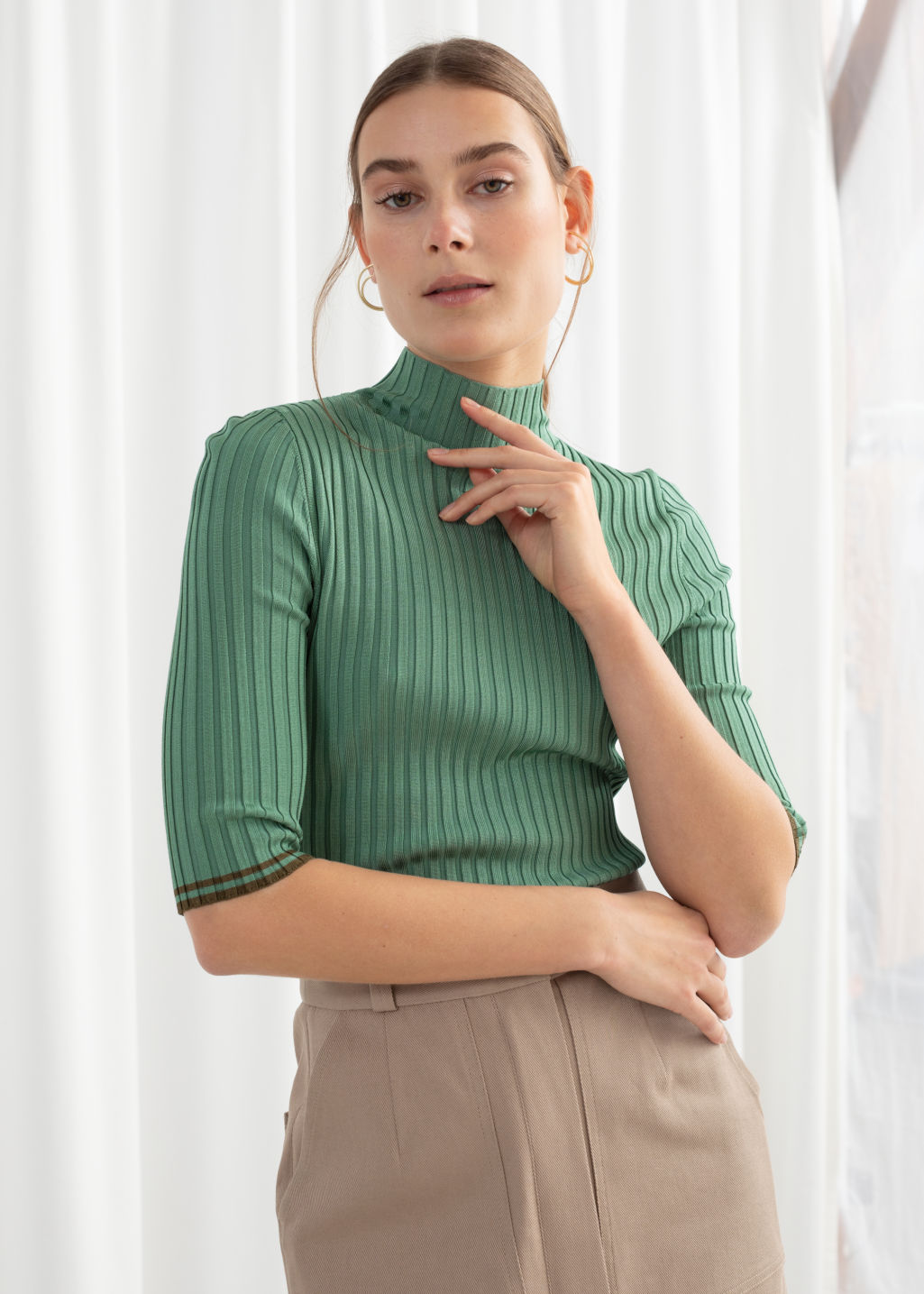 Model front image of Stories rib knit mock neck top in green