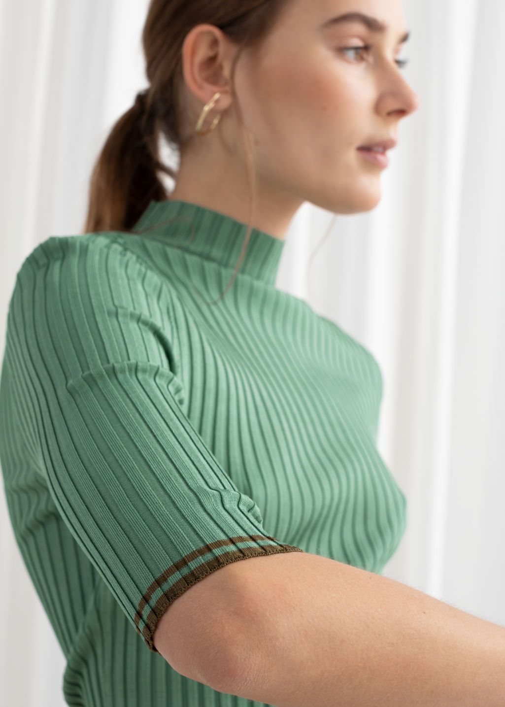 Model back image of Stories rib knit mock neck top in green