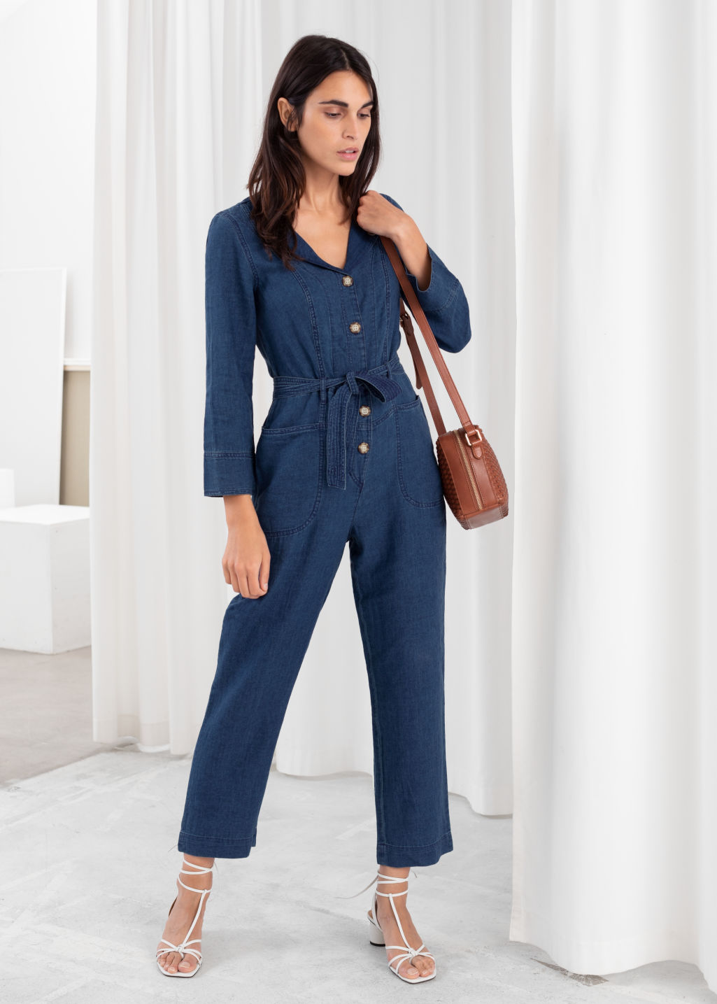 Model front image of Stories linen blend denim jumpsuit in blue