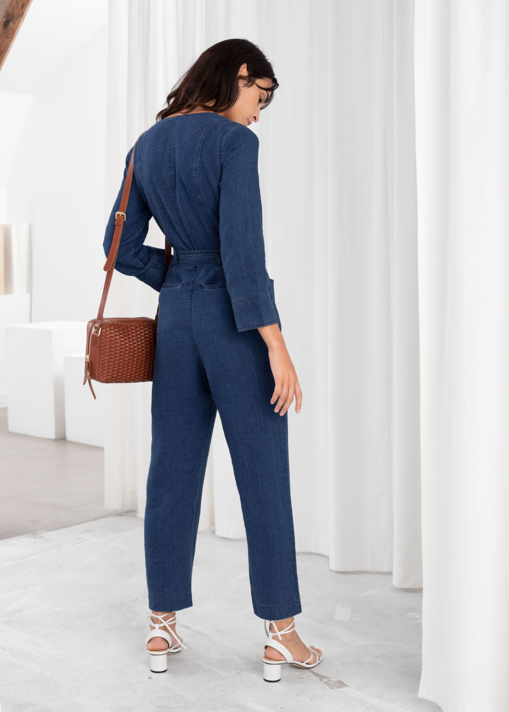 Model back image of Stories linen blend denim jumpsuit in blue