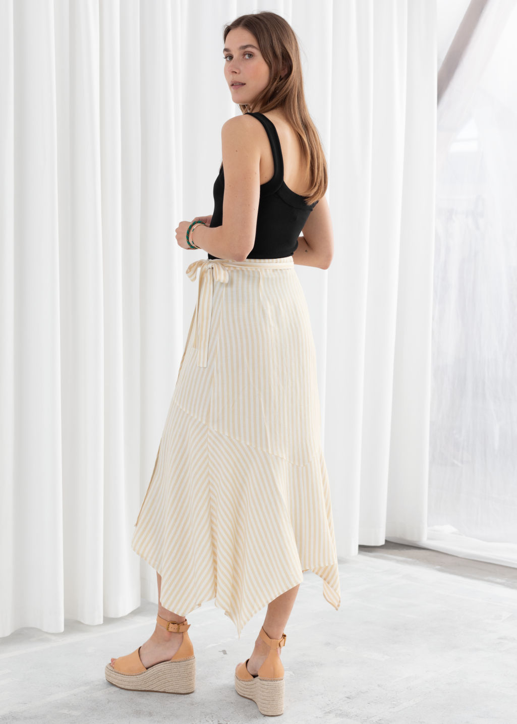 Model back image of Stories cotton blend handkerchief midi skirt in beige