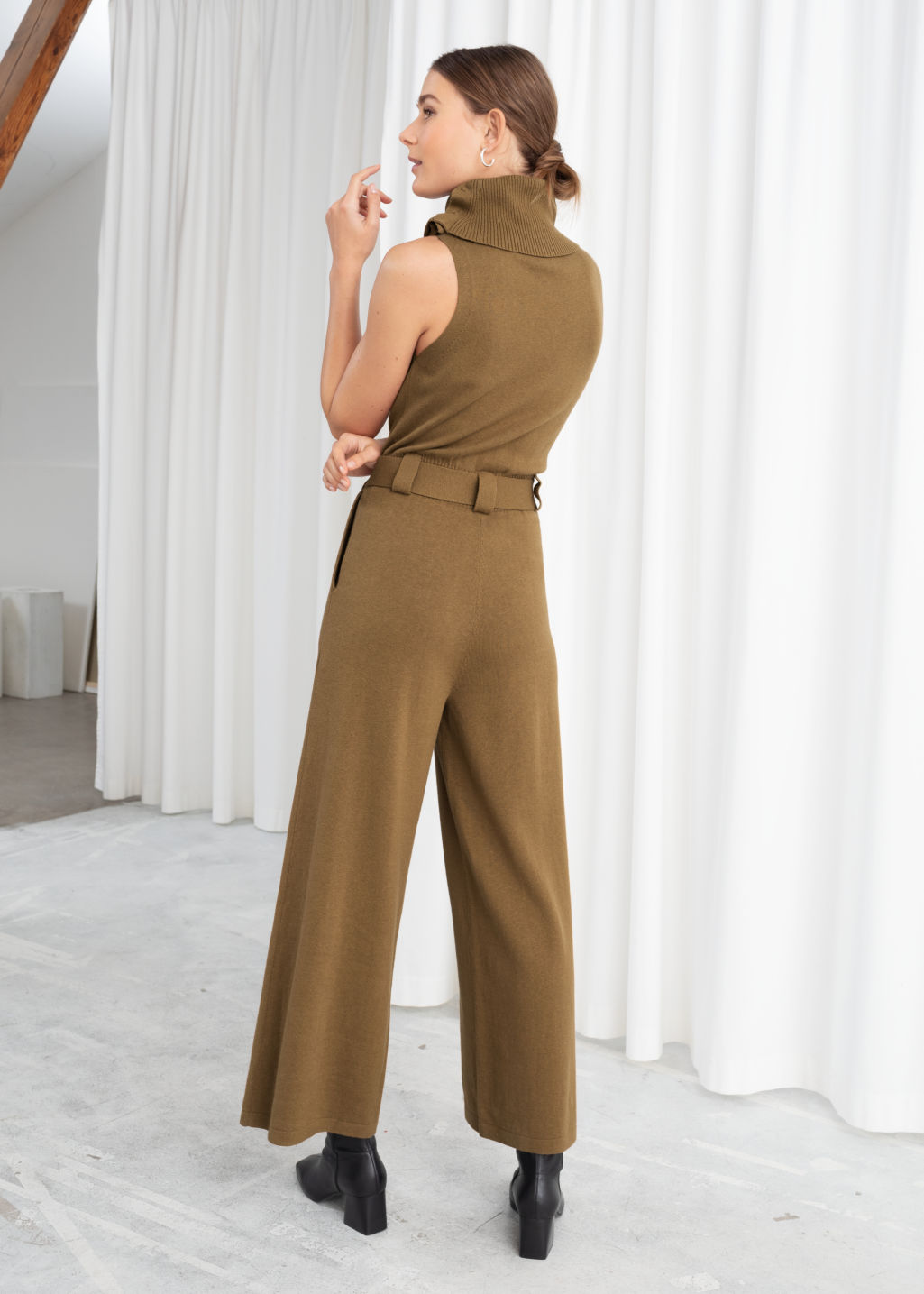 Model back image of Stories cotton blend turtleneck jumpsuit in beige
