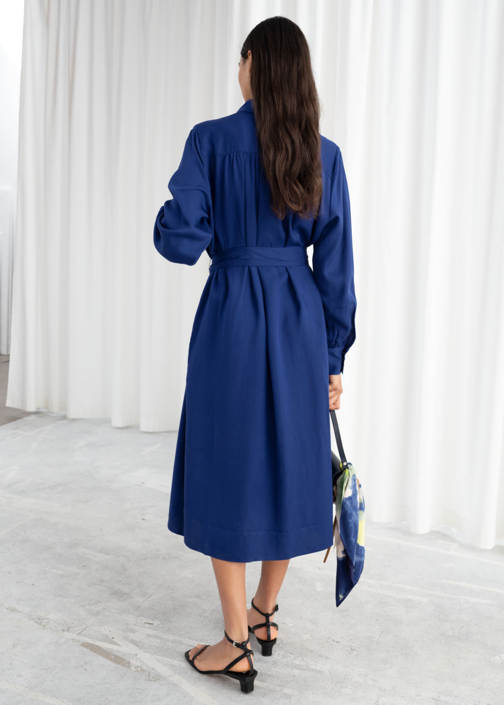 Model back image of Stories belted lyocell midi dress in blue
