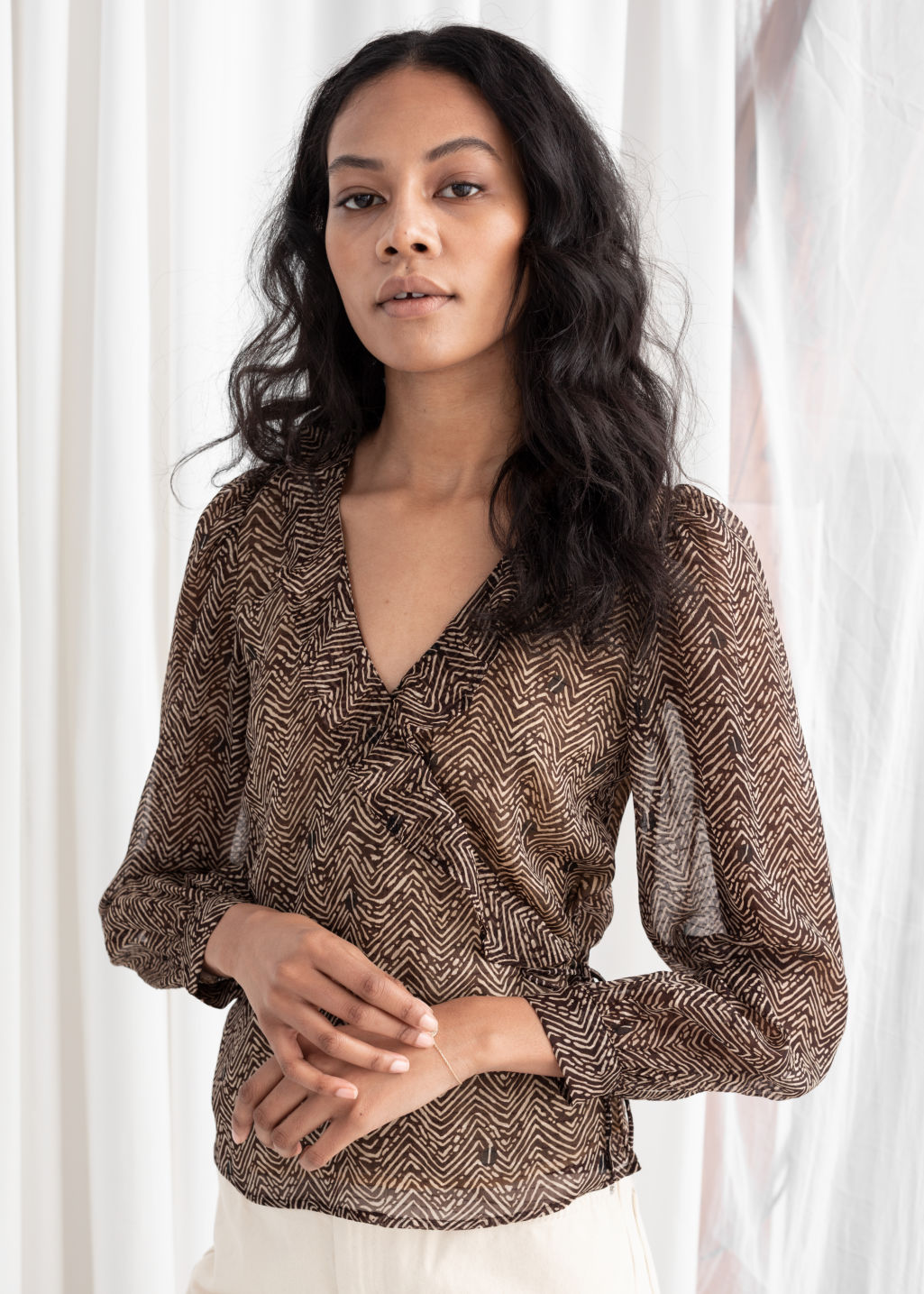 Model back image of Stories sheer floral wrap blouse in brown
