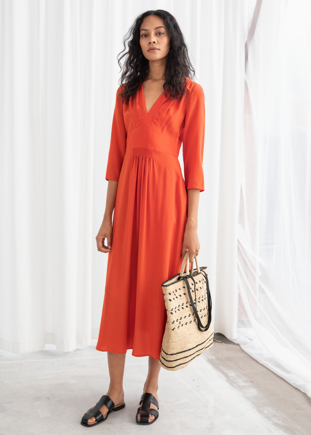 Model front image of Stories long sleeve empire midi dress in orange