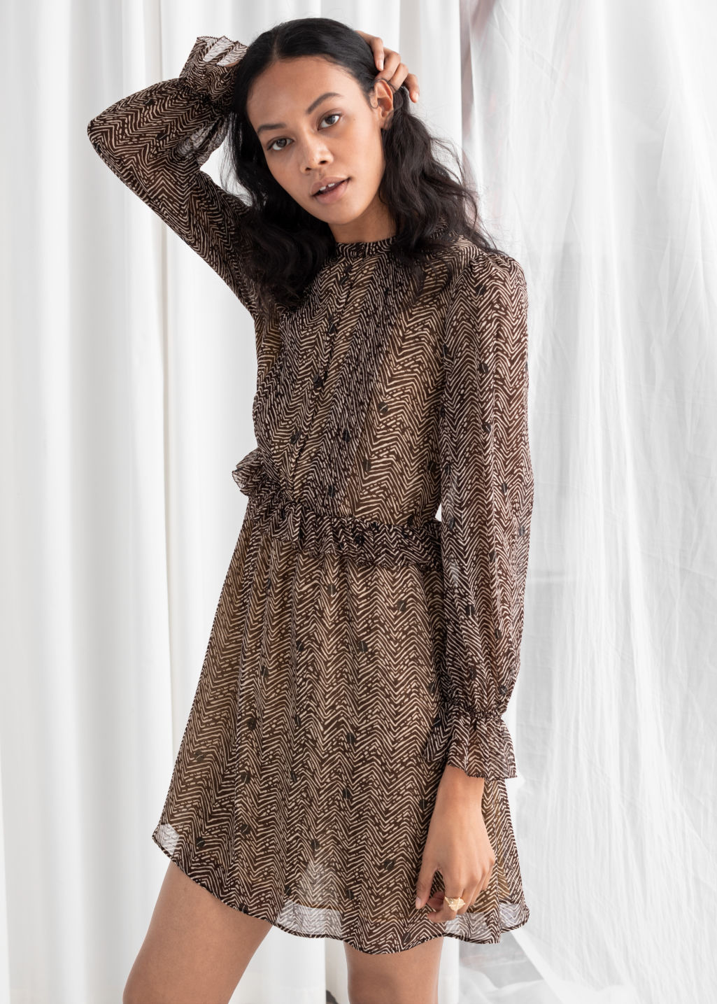 Model front image of Stories floral ruffled mini dress in brown
