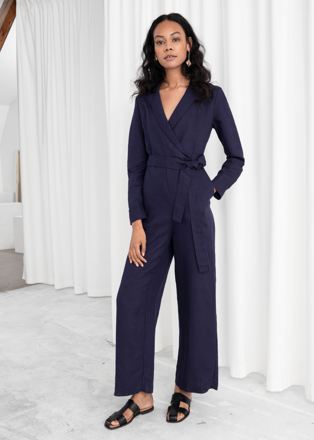 Model front image of Stories long sleeve wrap jumpsuit in purple