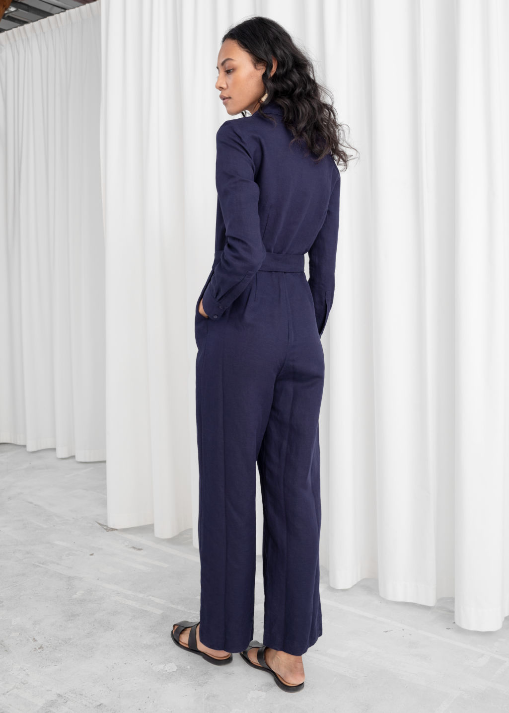 Model back image of Stories long sleeve wrap jumpsuit in purple