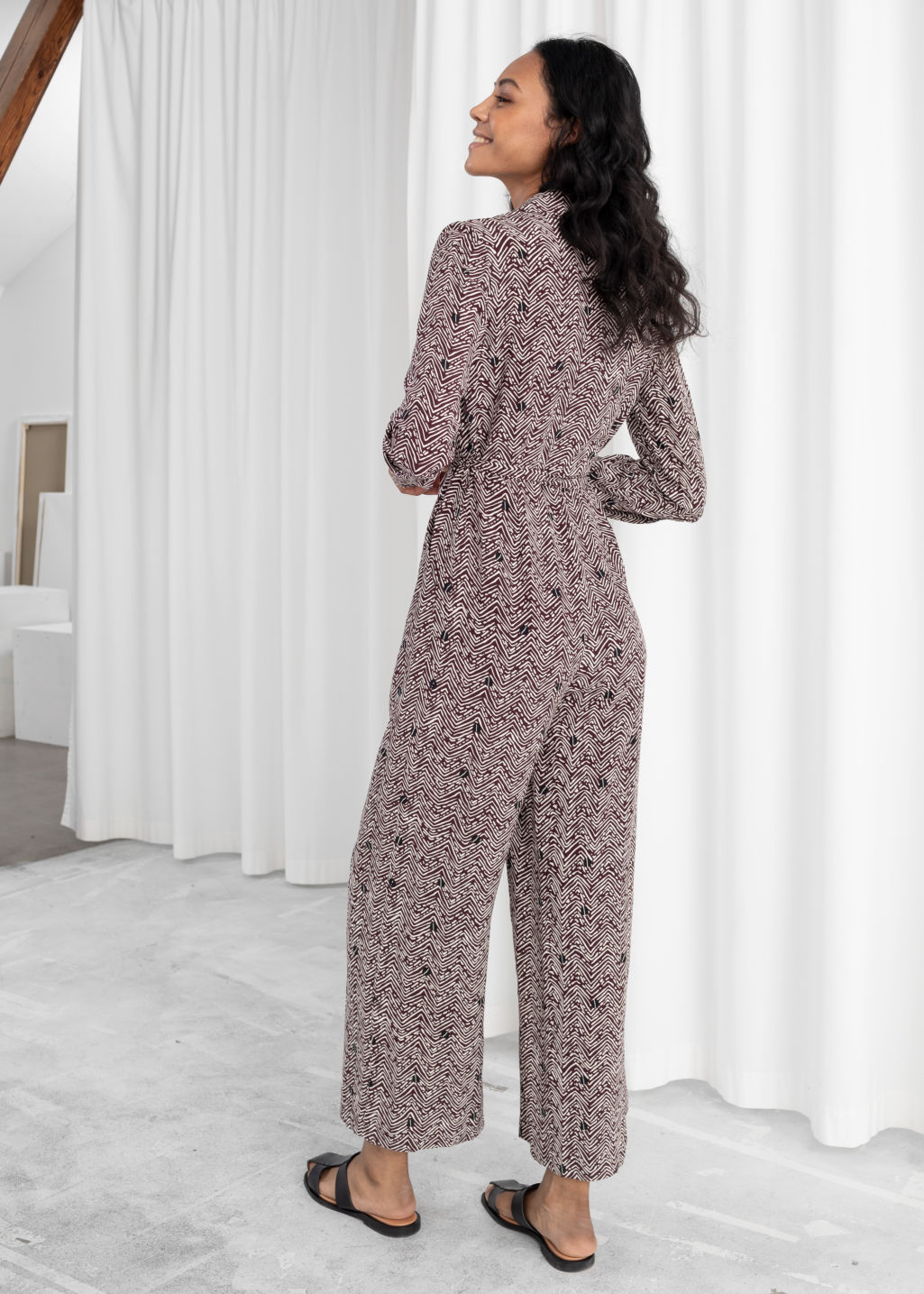 Model back image of Stories long sleeve wrap jumpsuit in brown
