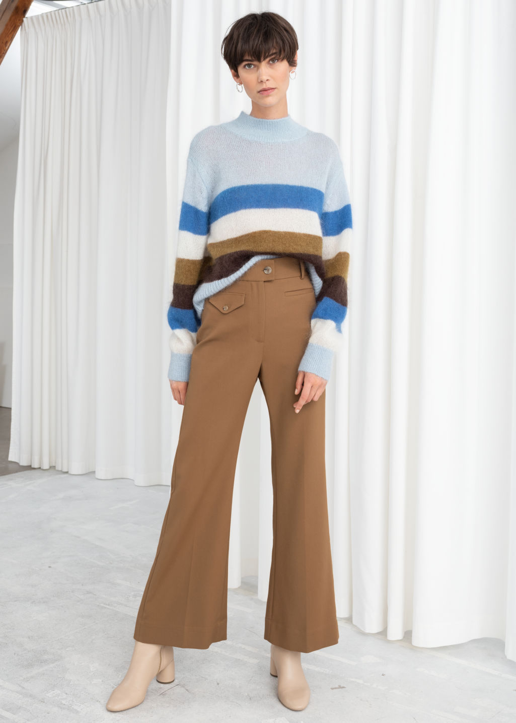 Model front image of Stories high waisted flared trousers in beige
