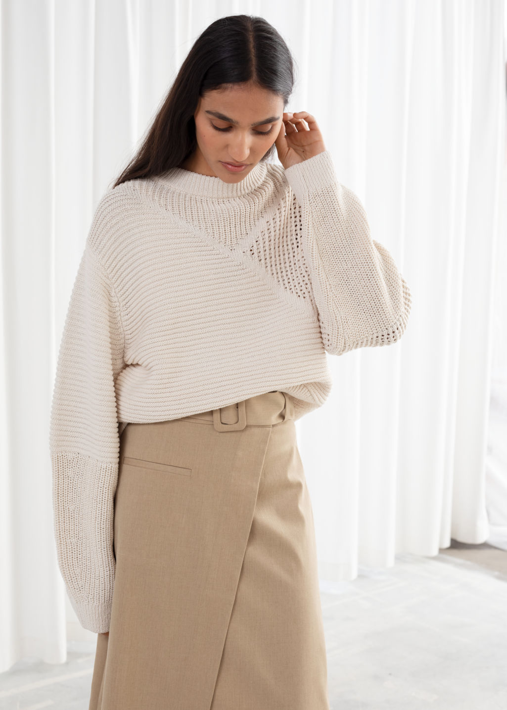 Model front image of Stories mixed texture cotton sweater in beige