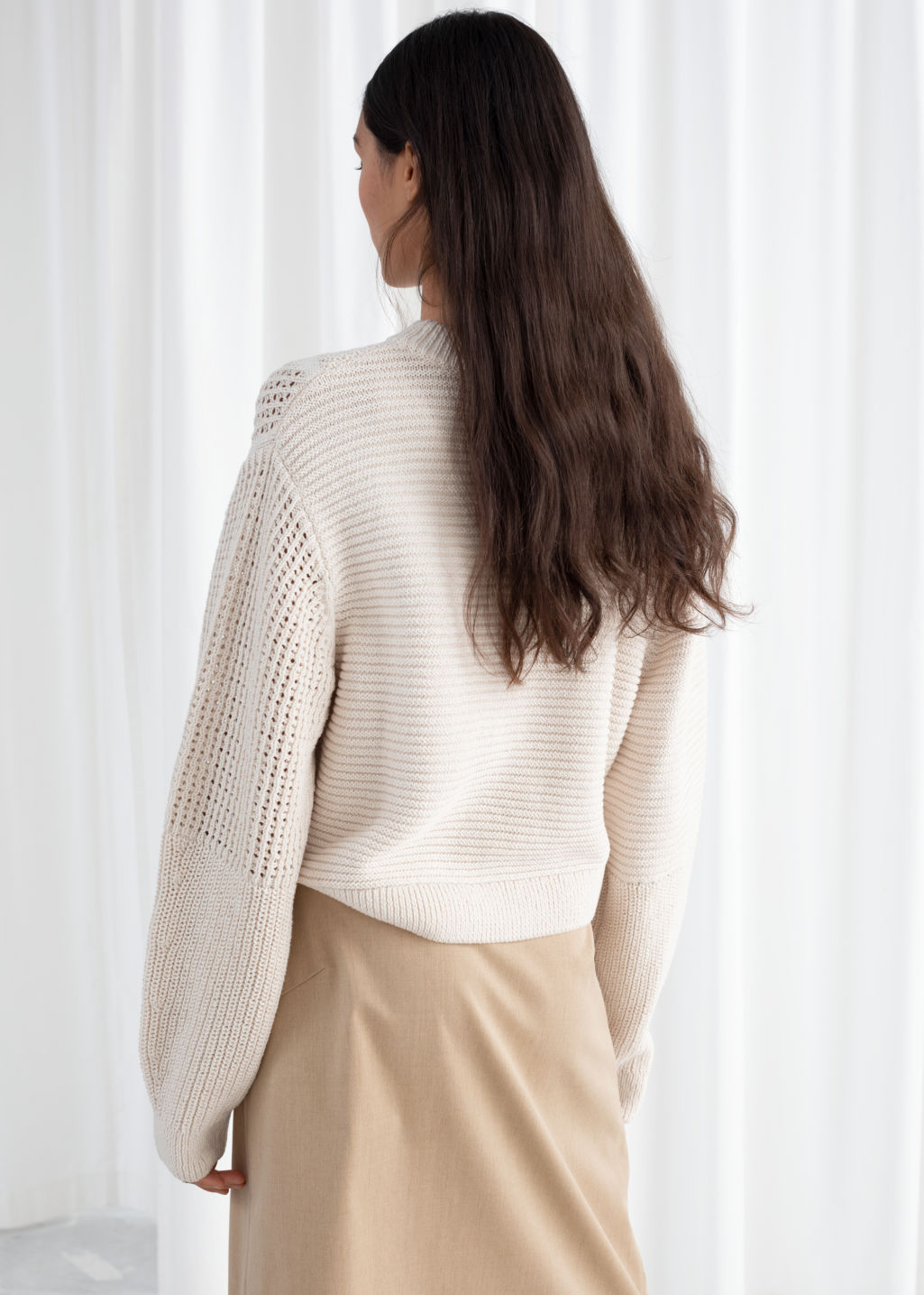 Model back image of Stories mixed texture cotton sweater in beige