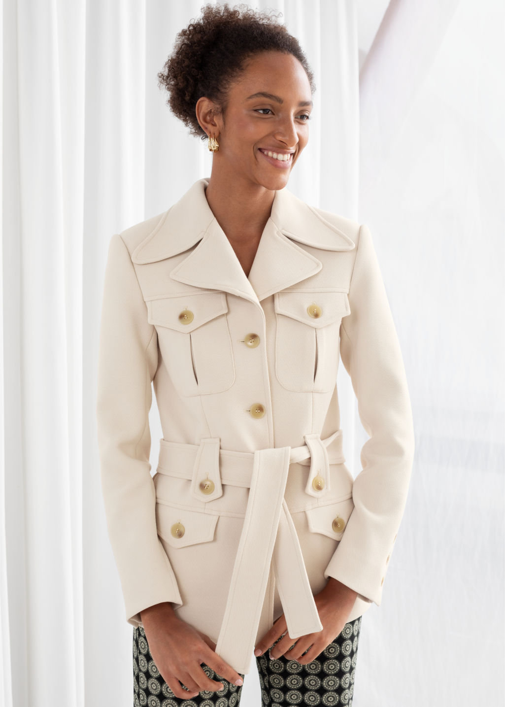 Model front image of Stories structured belted workwear jacket in beige