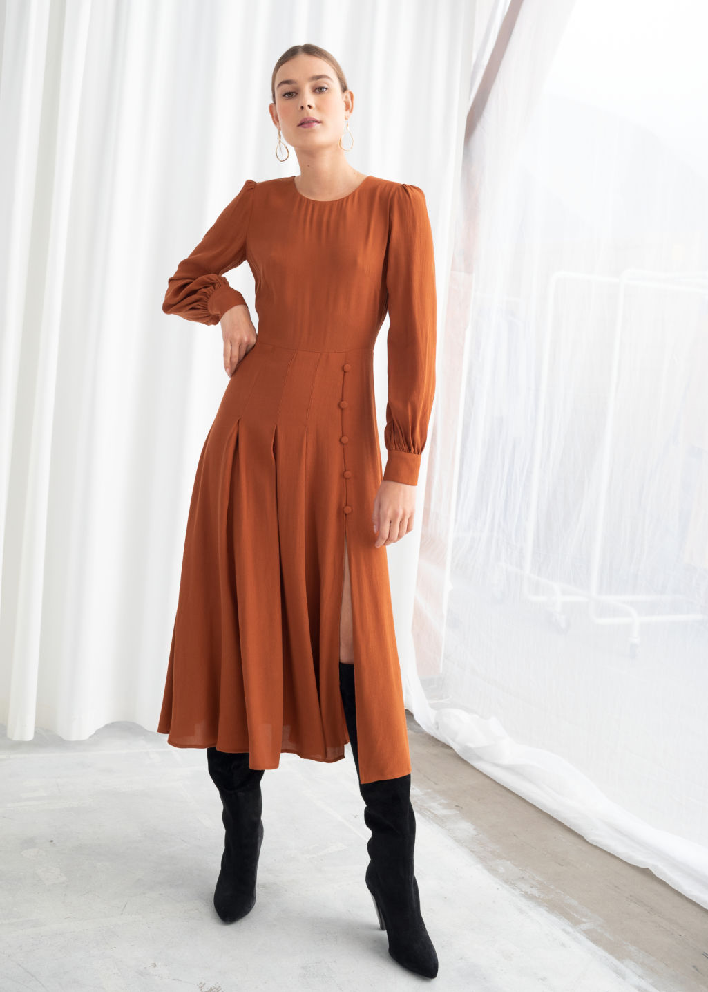 Model front image of Stories long sleeve button slit midi dress in orange