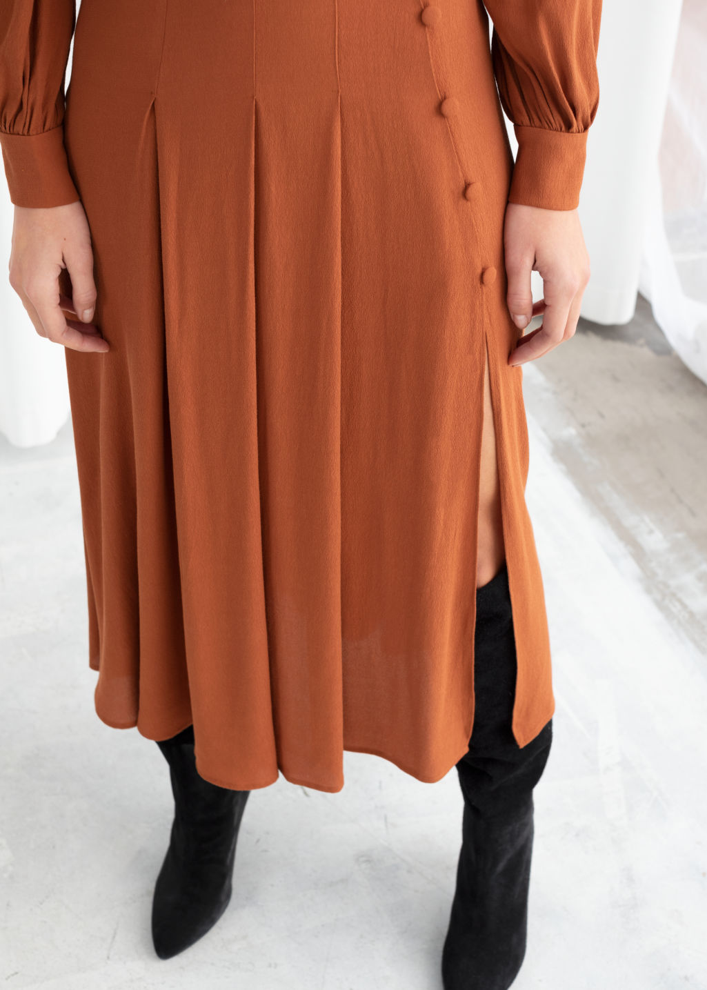 Model back image of Stories long sleeve button slit midi dress in orange