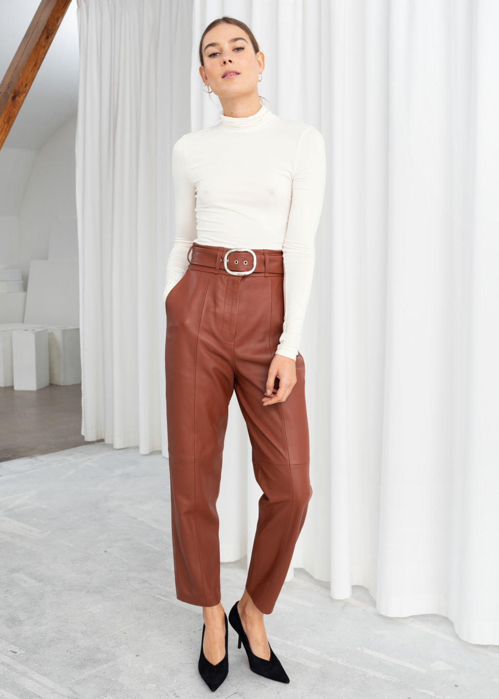 Model front image of Stories belted leather trousers in orange