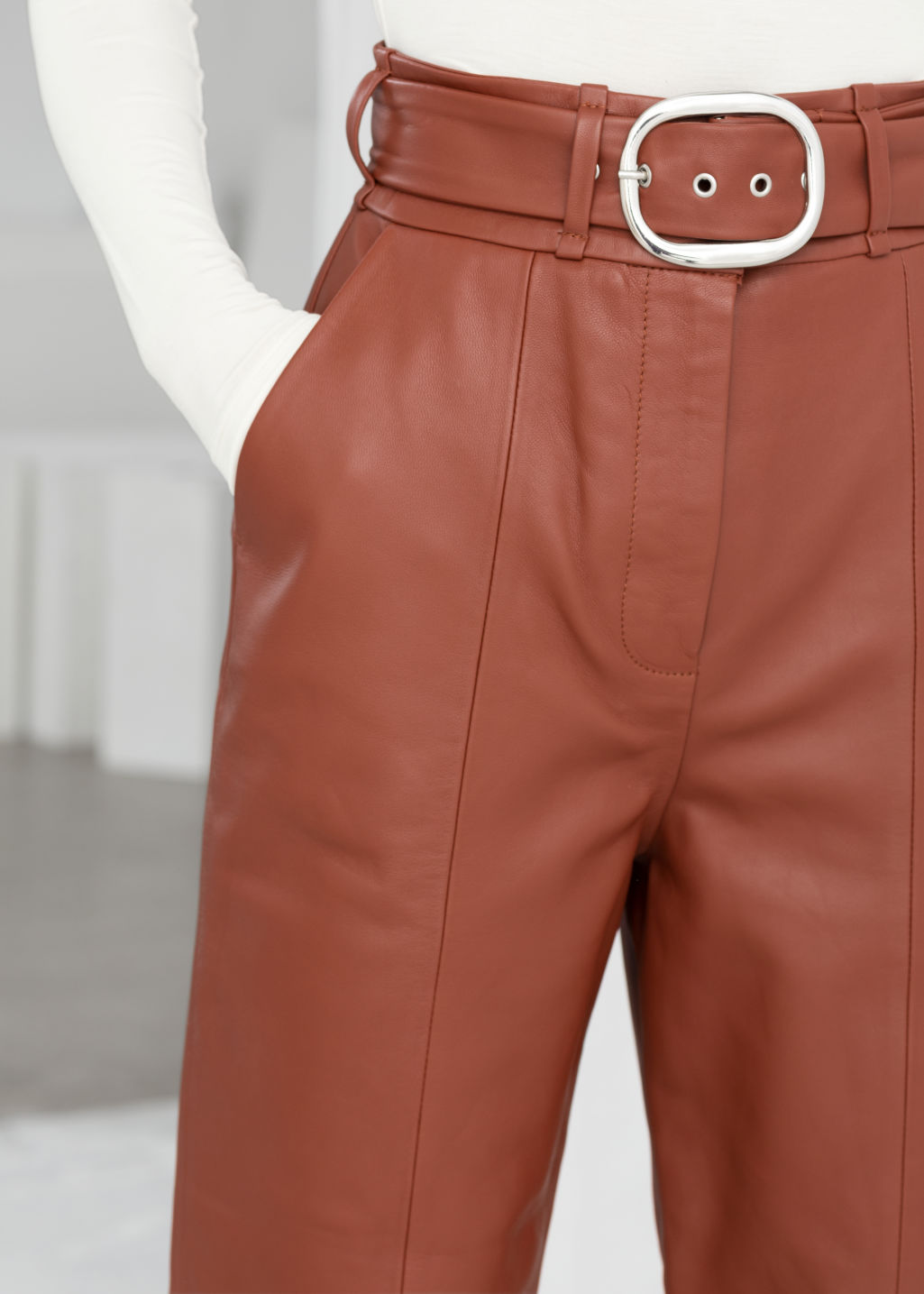 Model back image of Stories belted leather trousers in orange