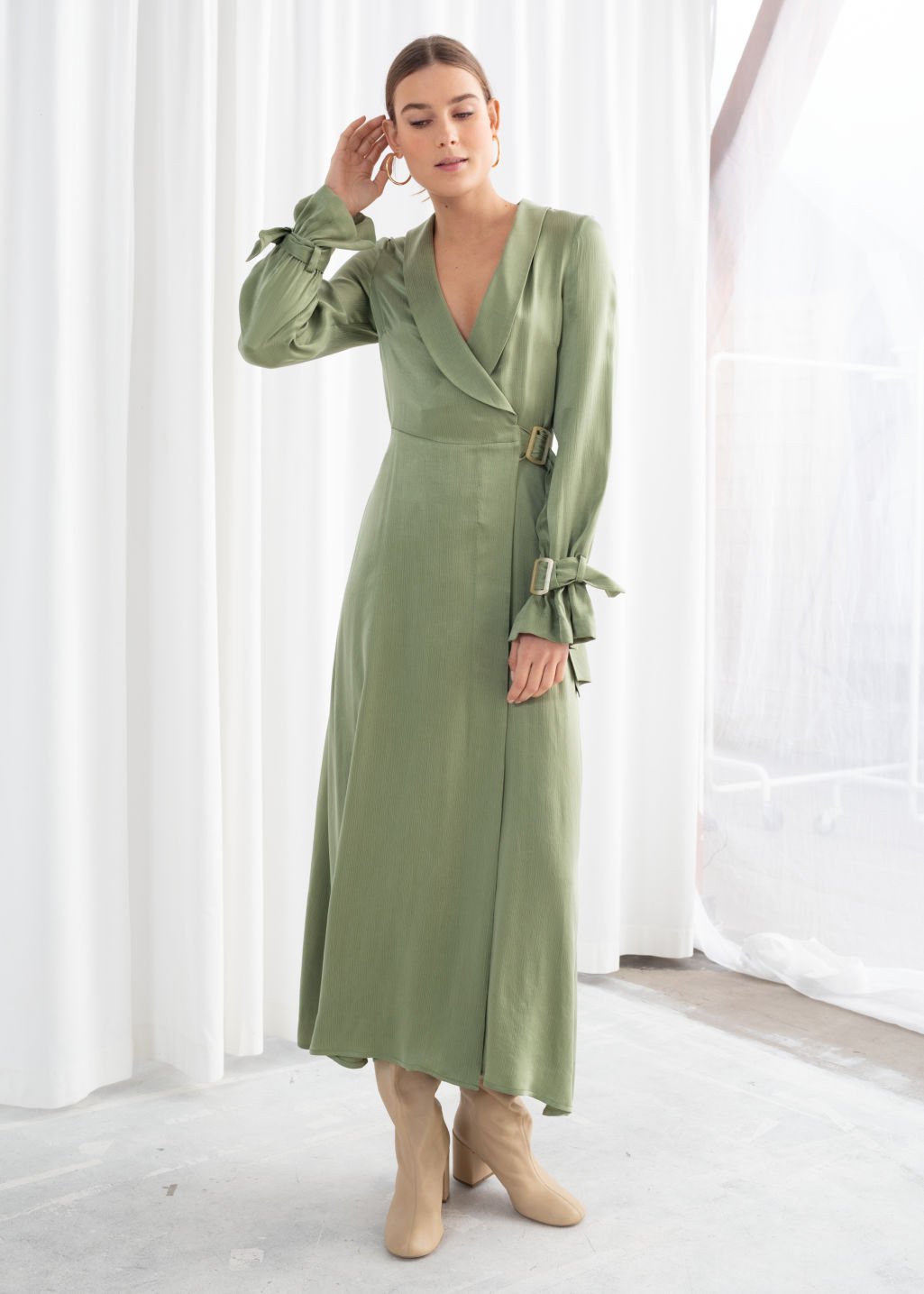 Model front image of Stories belted wrap maxi dress in green