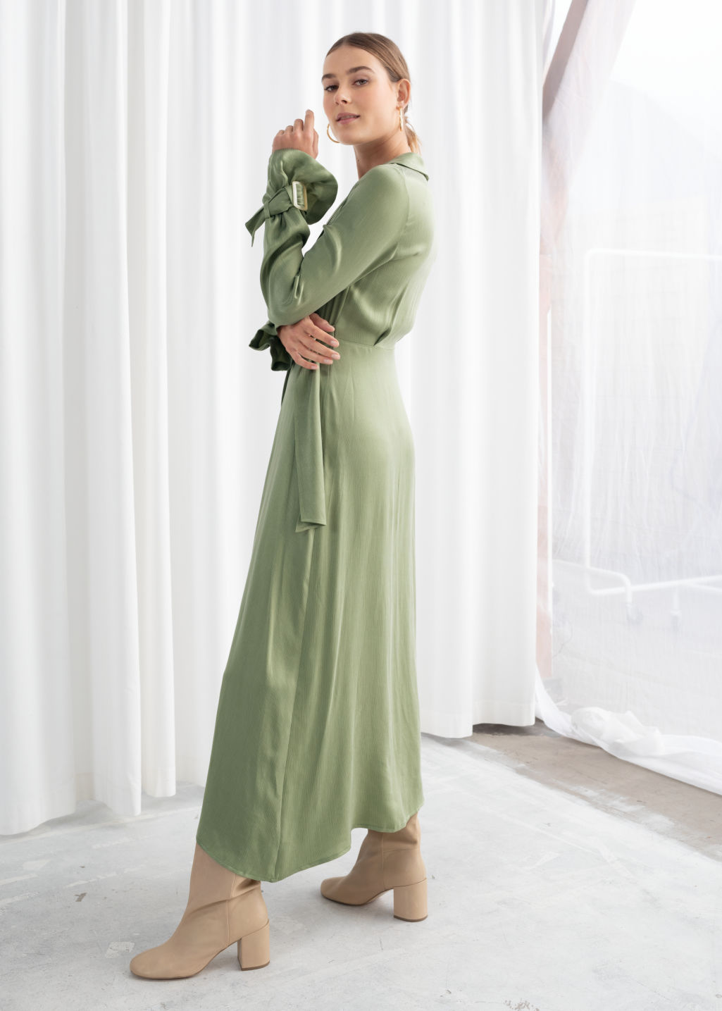 Model back image of Stories belted wrap maxi dress in green