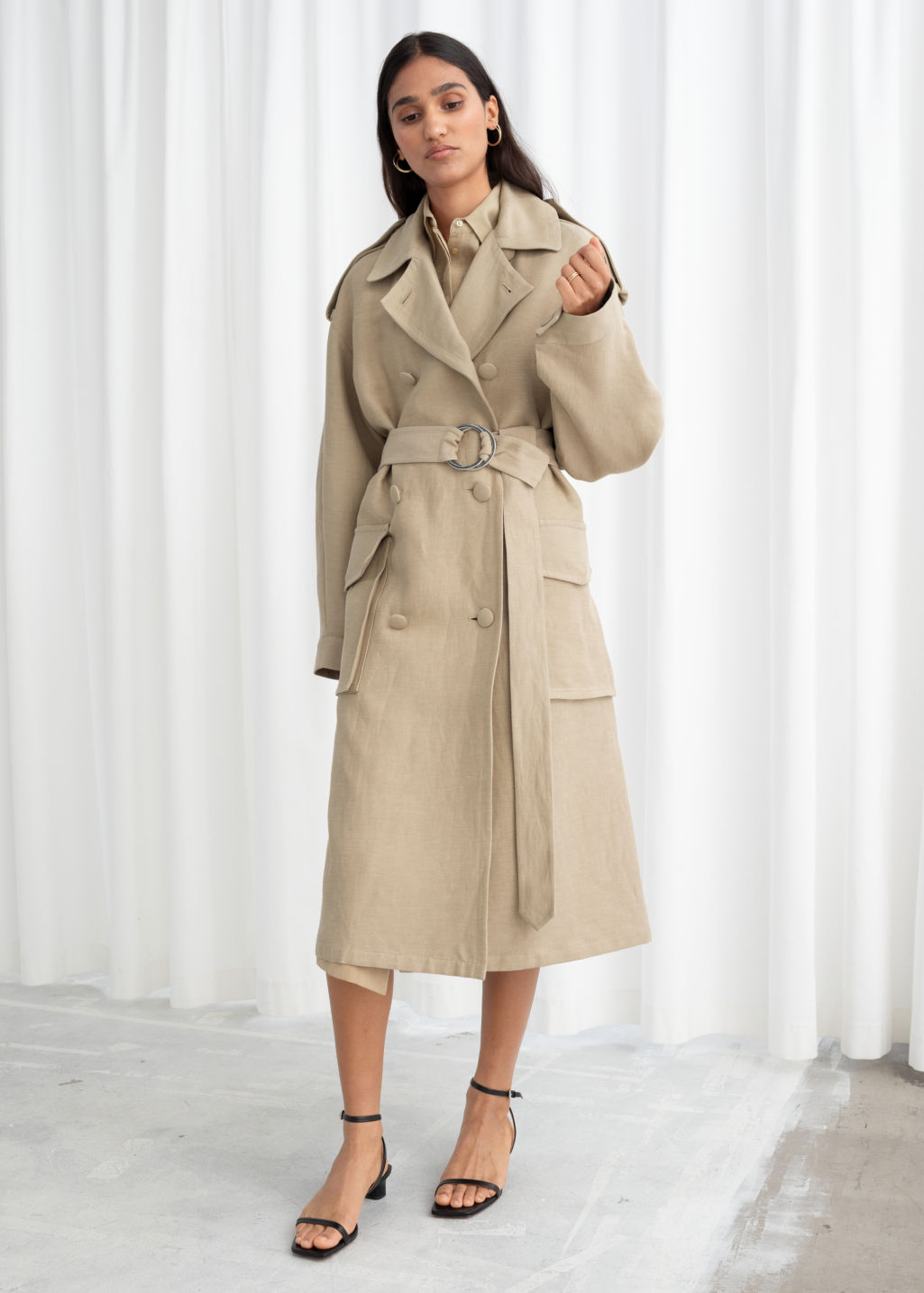 Model front image of Stories belted linen blend trench coat in beige