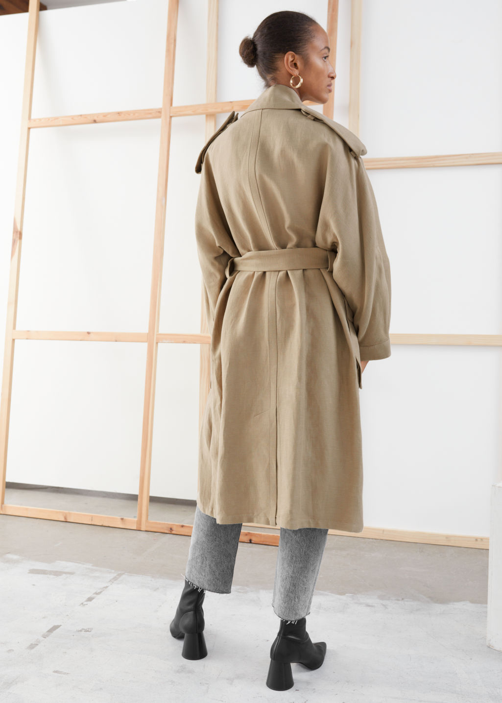 Model back image of Stories belted linen blend trench coat in beige