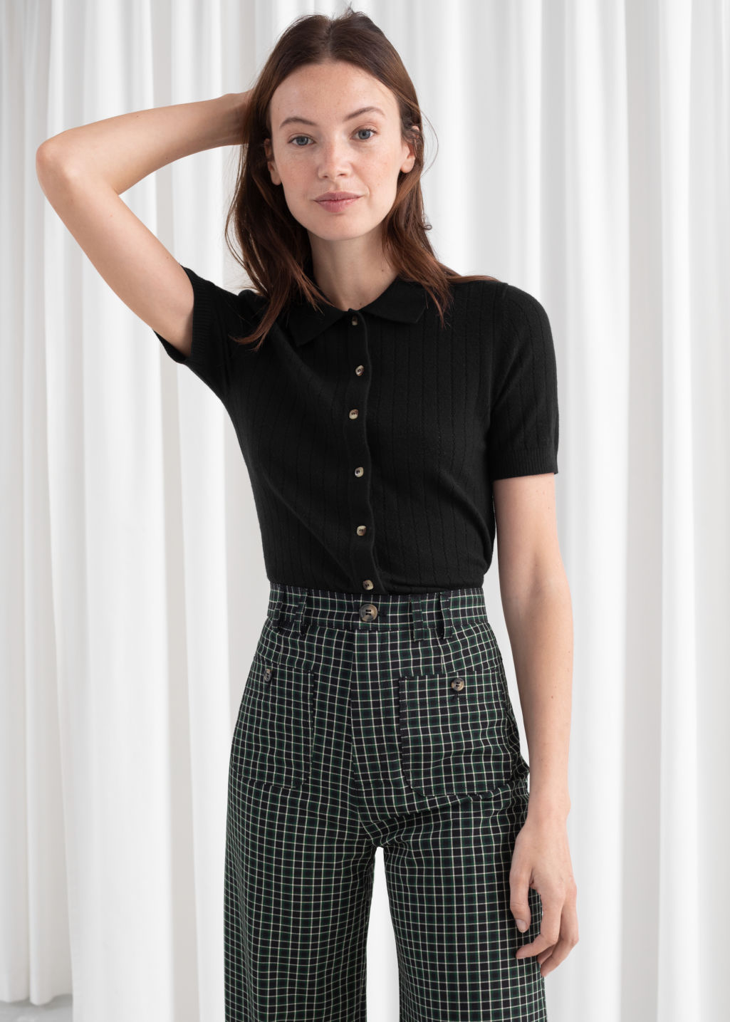 Model front image of Stories eyelet knit polo top in black