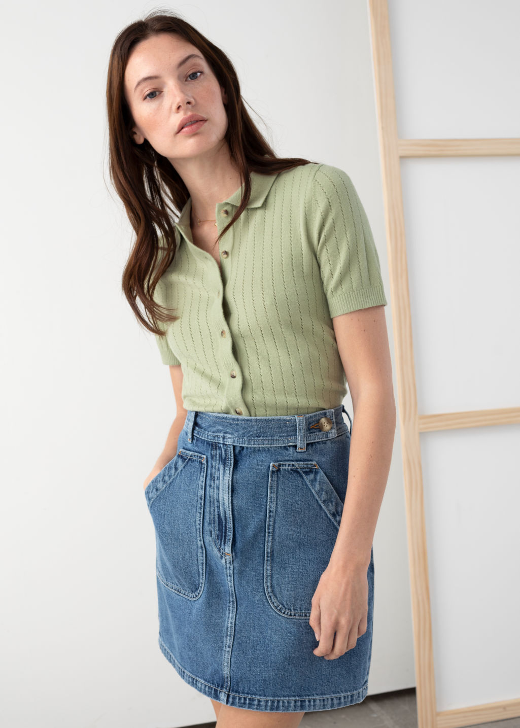 Model front image of Stories eyelet knit polo top in green