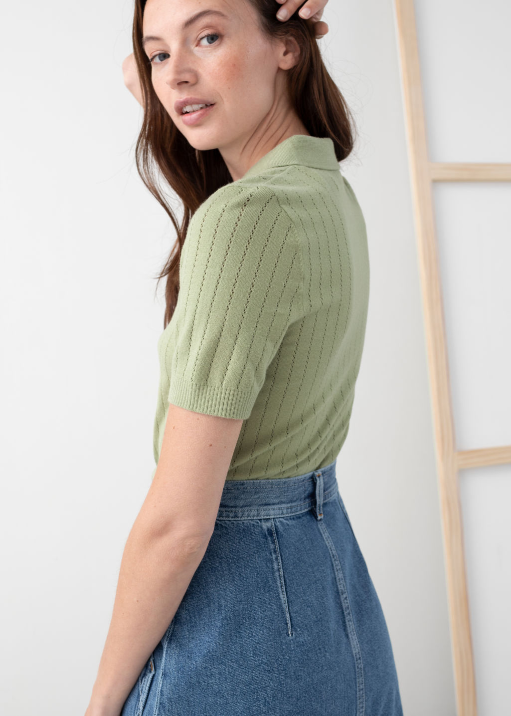 Model back image of Stories eyelet knit polo top in green