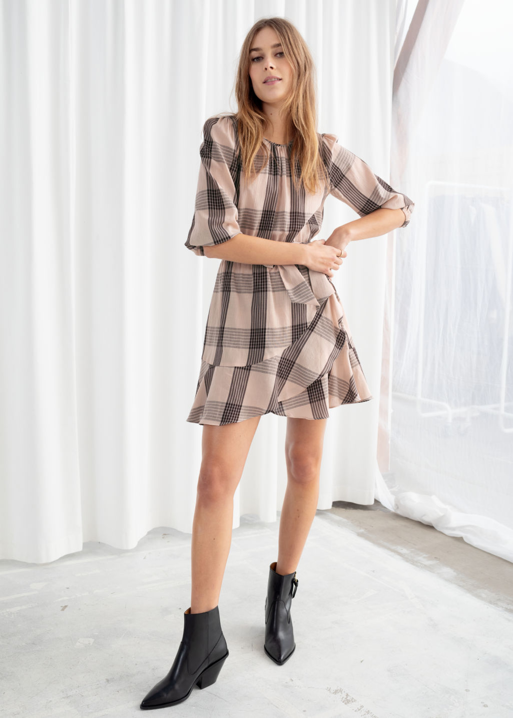 Model front image of Stories belted plaid mini dress in beige