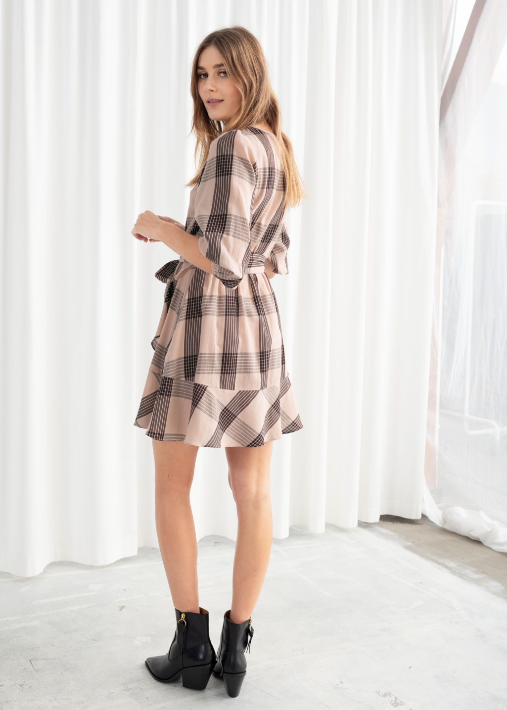 Model back image of Stories belted plaid mini dress in beige