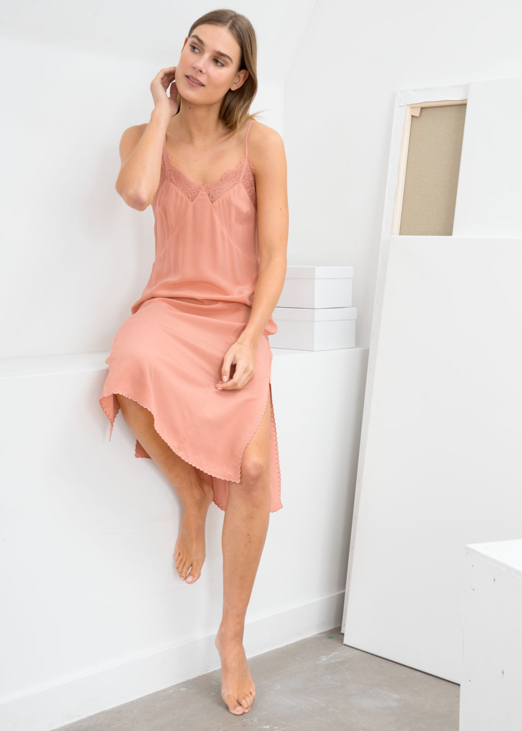 Model front image of Stories silk slip dress in pink