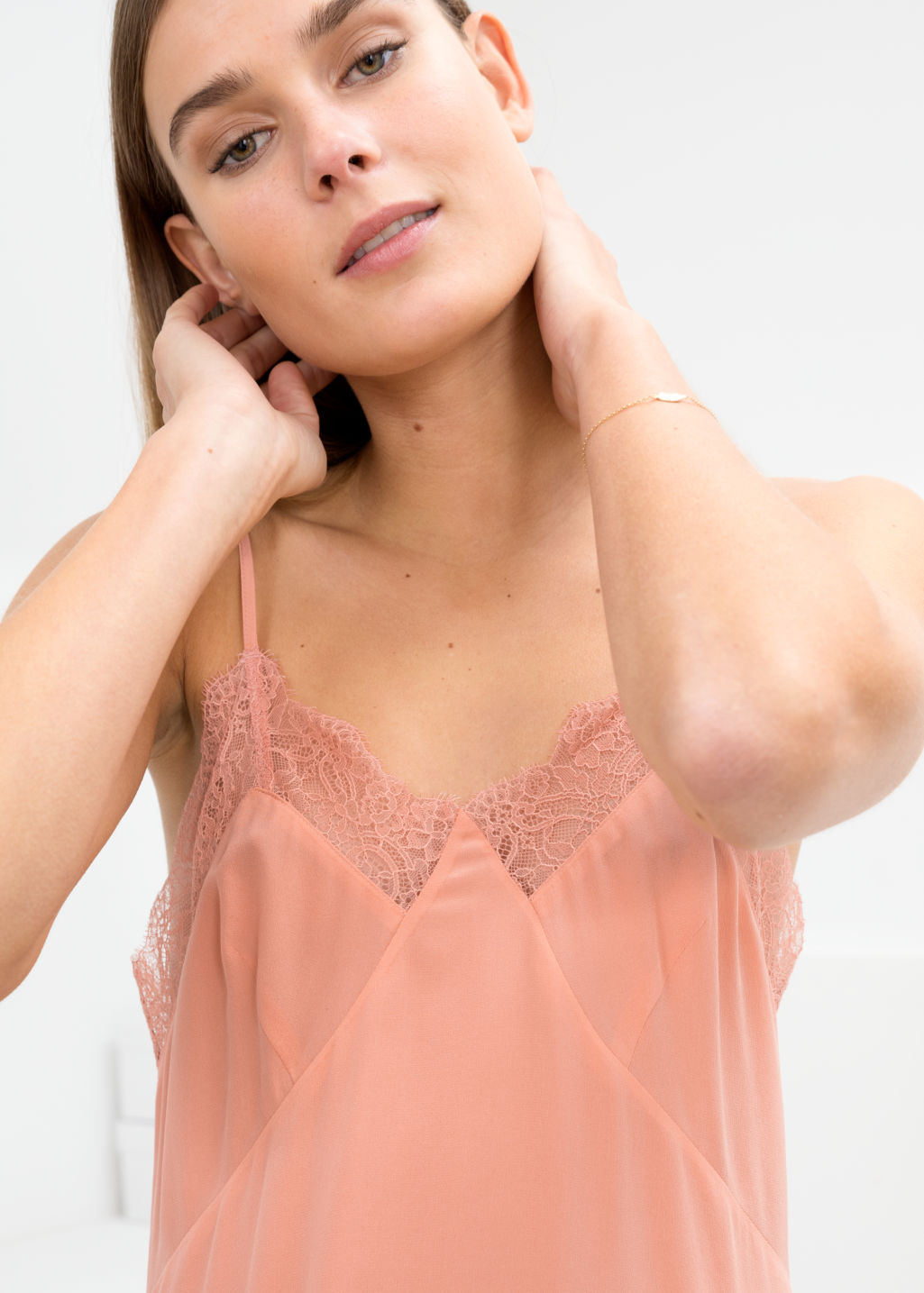 Model back image of Stories silk slip dress in pink