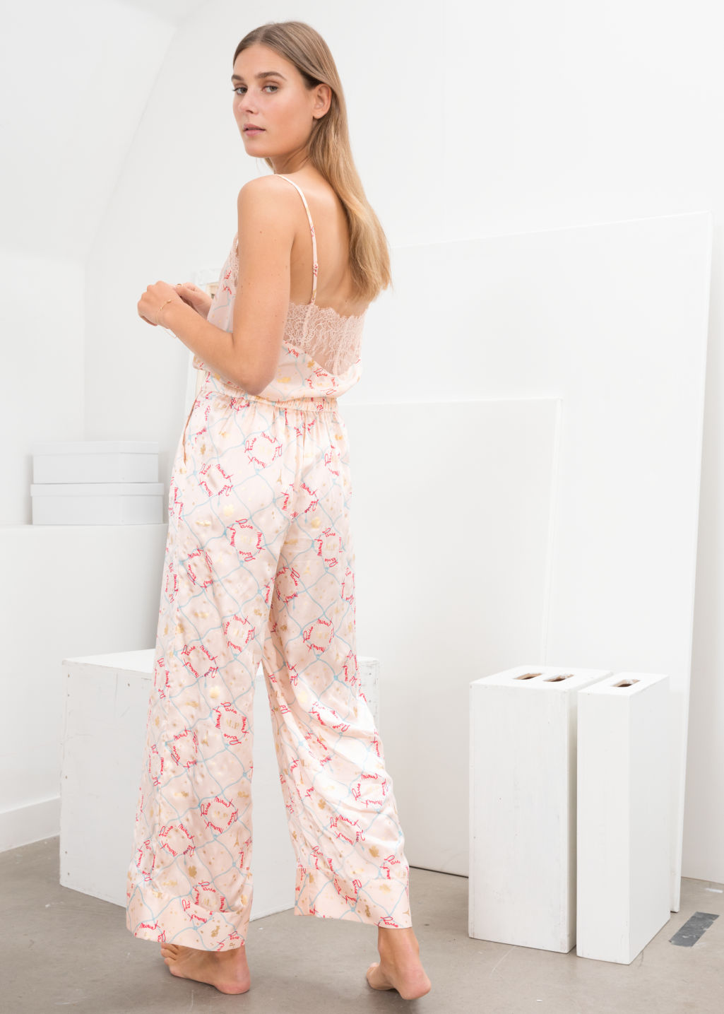 Model back image of Stories silk lounge trousers in pink