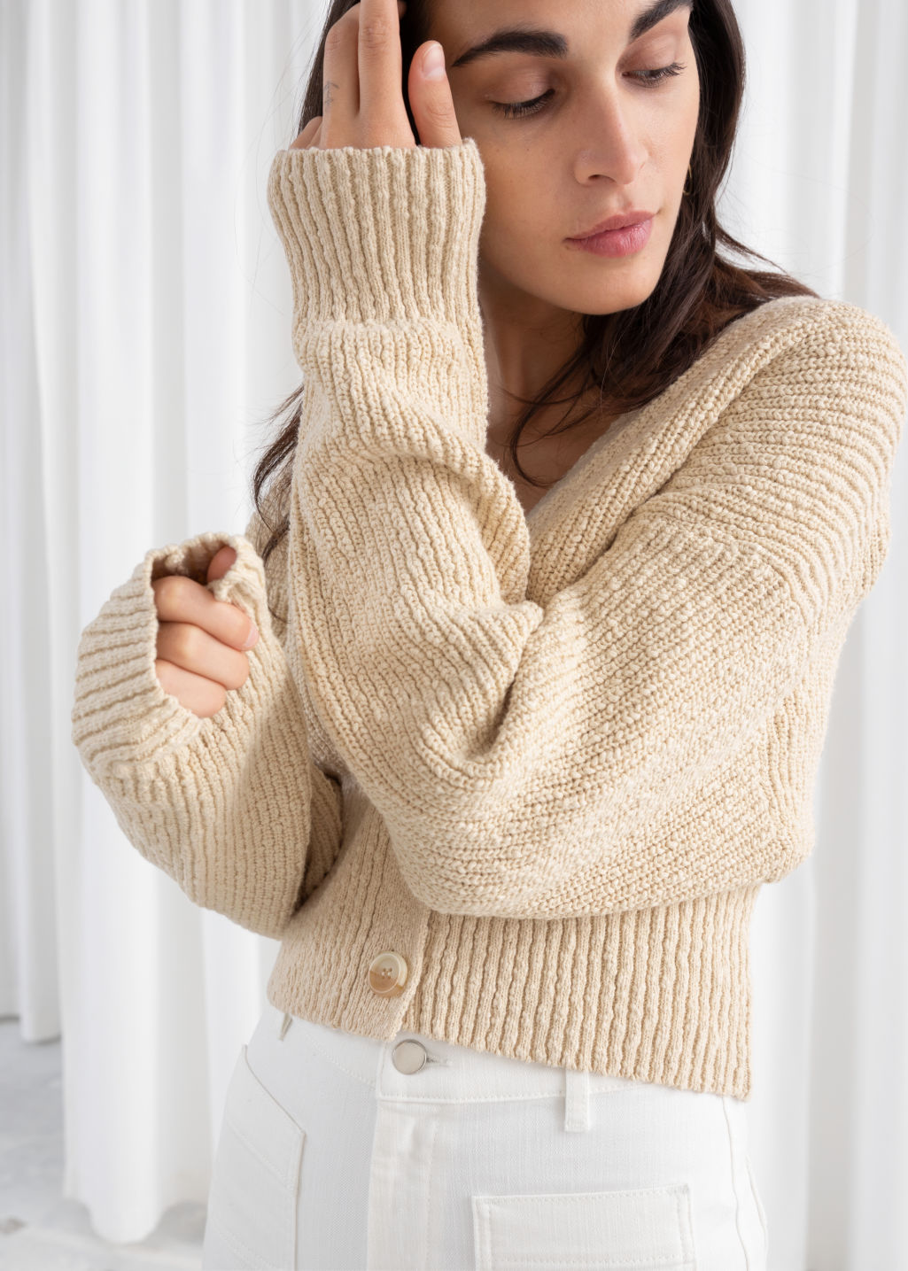 Model front image of Stories cropped textured cotton cardigan in beige